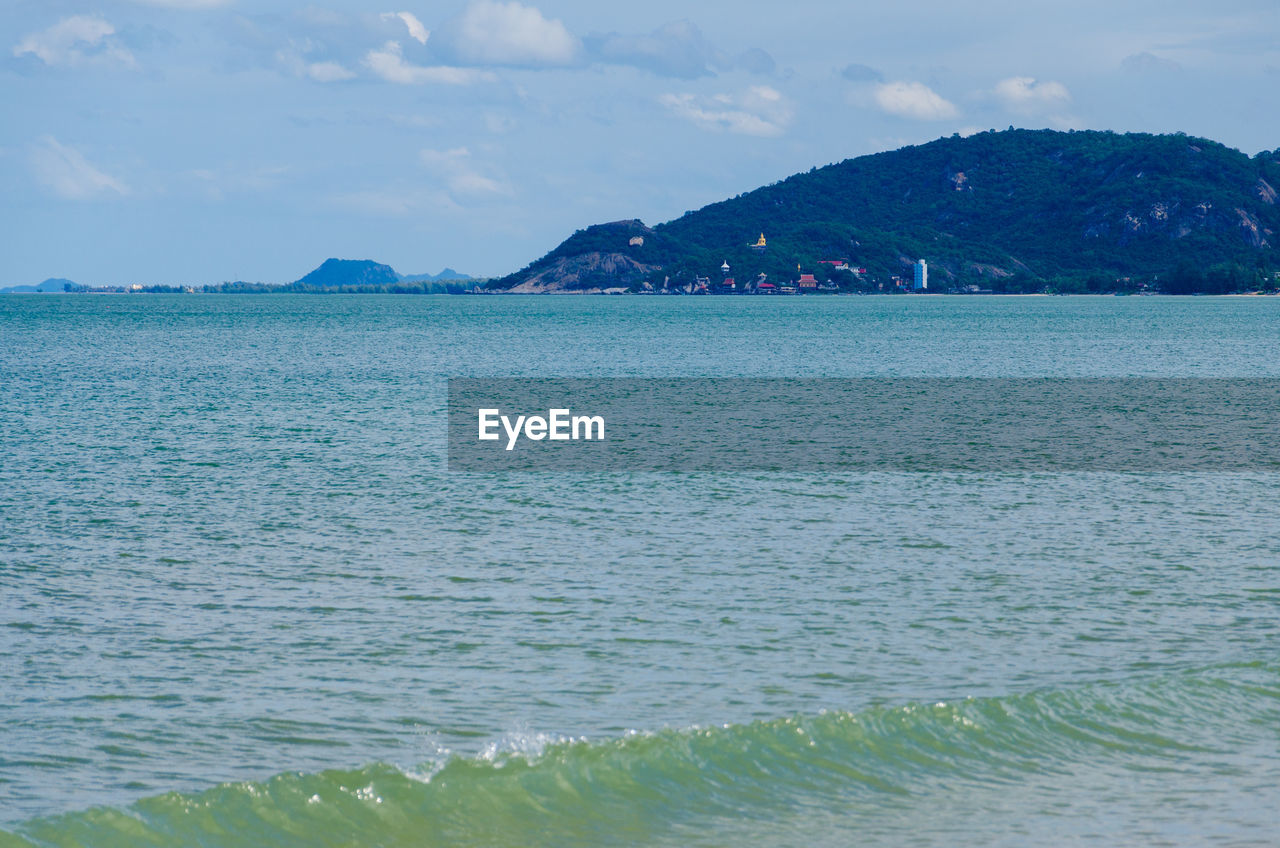 water, sky, scenics - nature, sea, beauty in nature, tranquility, tranquil scene, cloud - sky, waterfront, nature, no people, day, idyllic, mountain, beach, non-urban scene, outdoors, land, rippled, turquoise colored