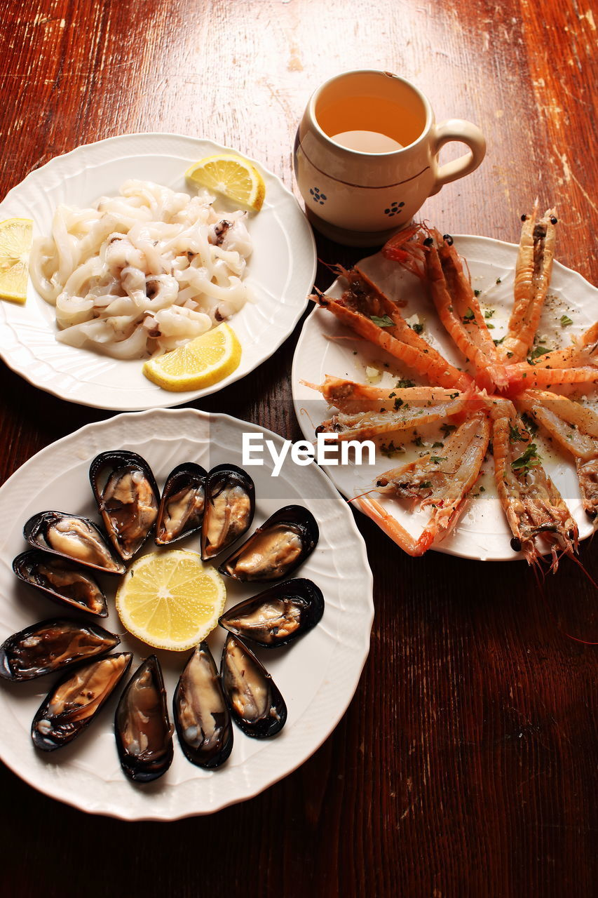 food, food and drink, seafood, healthy eating, lemon, plate, freshness, serving size, slice, table, no people, ready-to-eat, indoors, prawn, drink, cooked, close-up, day