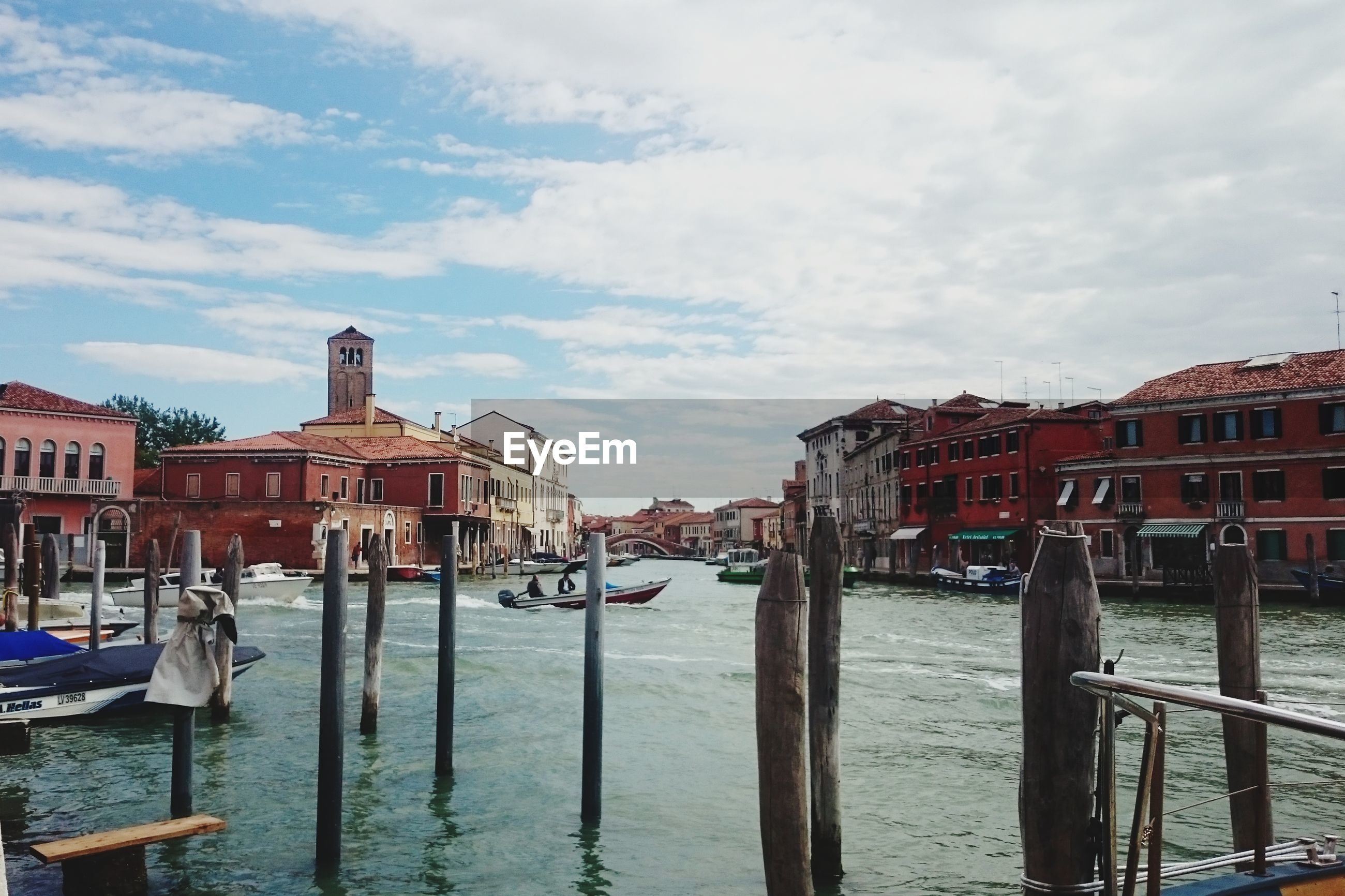 architecture, built structure, building exterior, water, cloud - sky, sky, building, nautical vessel, transportation, mode of transportation, nature, canal, city, residential district, wooden post, day, post, house, travel destinations, no people, outdoors