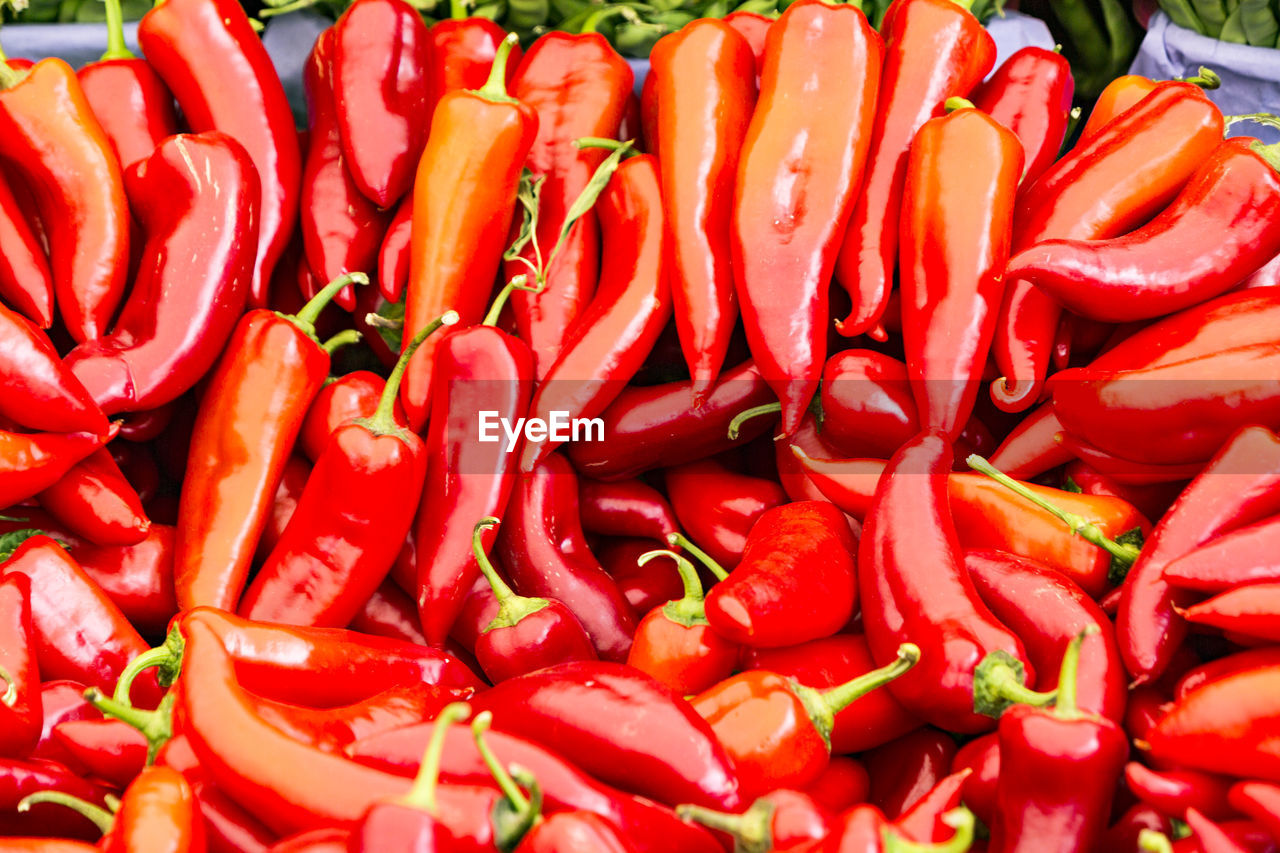 HIGH ANGLE VIEW OF RED CHILI PEPPERS FOR SALE