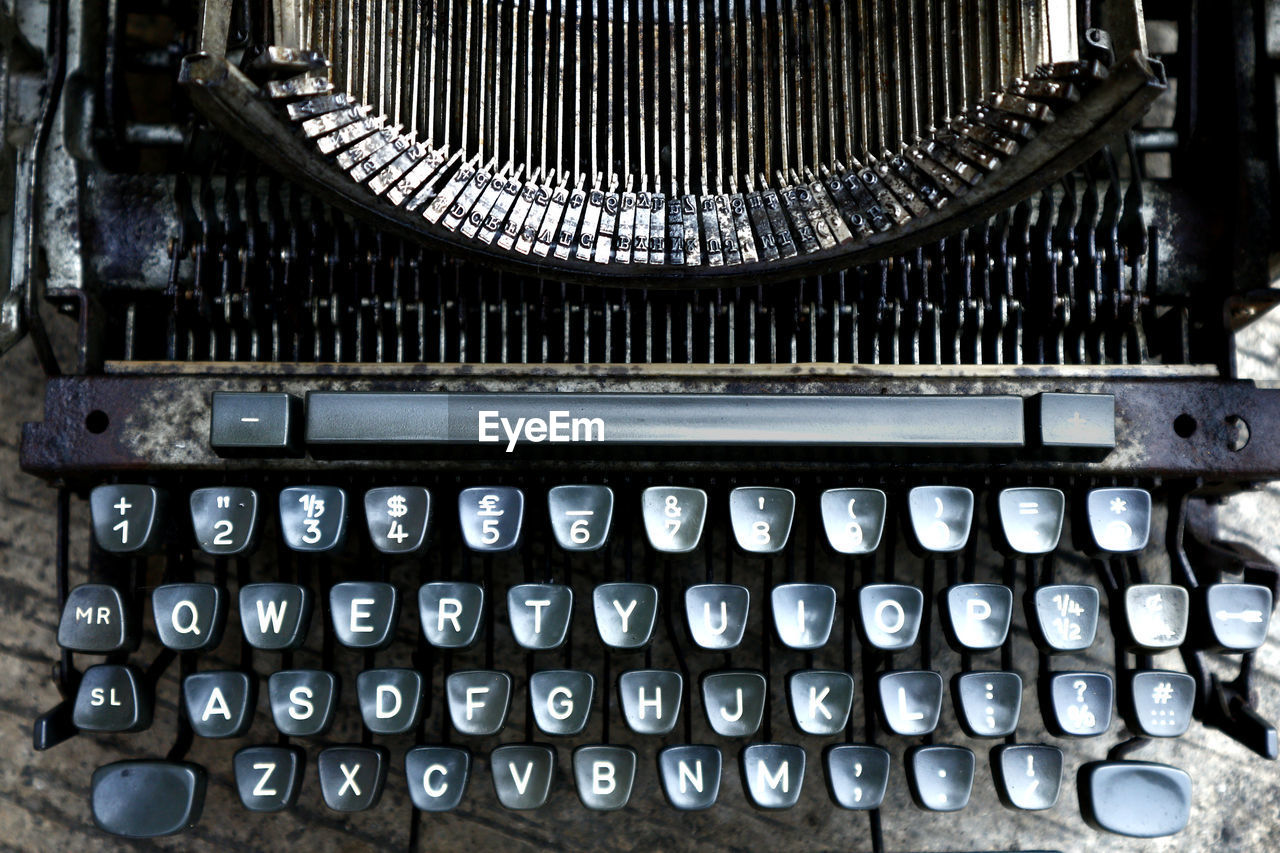 typewriter, technology, antique, indoors, close-up, retro styled, number, letter, machinery, old, alphabet, no people, equipment, text, obsolete, communication, document, business, high angle view, keyboard