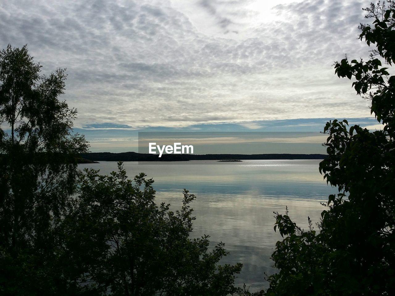 Idyllic shot of lake against sunset sky