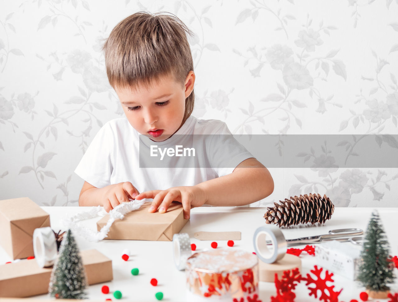 BOY LOOKING AT TABLE IN RESTAURANT