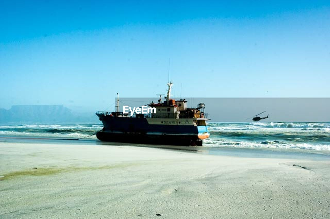 sea, nautical vessel, beach, water, transportation, sand, horizon over water, nature, clear sky, outdoors, sky, day, blue, no people, beauty in nature, wave