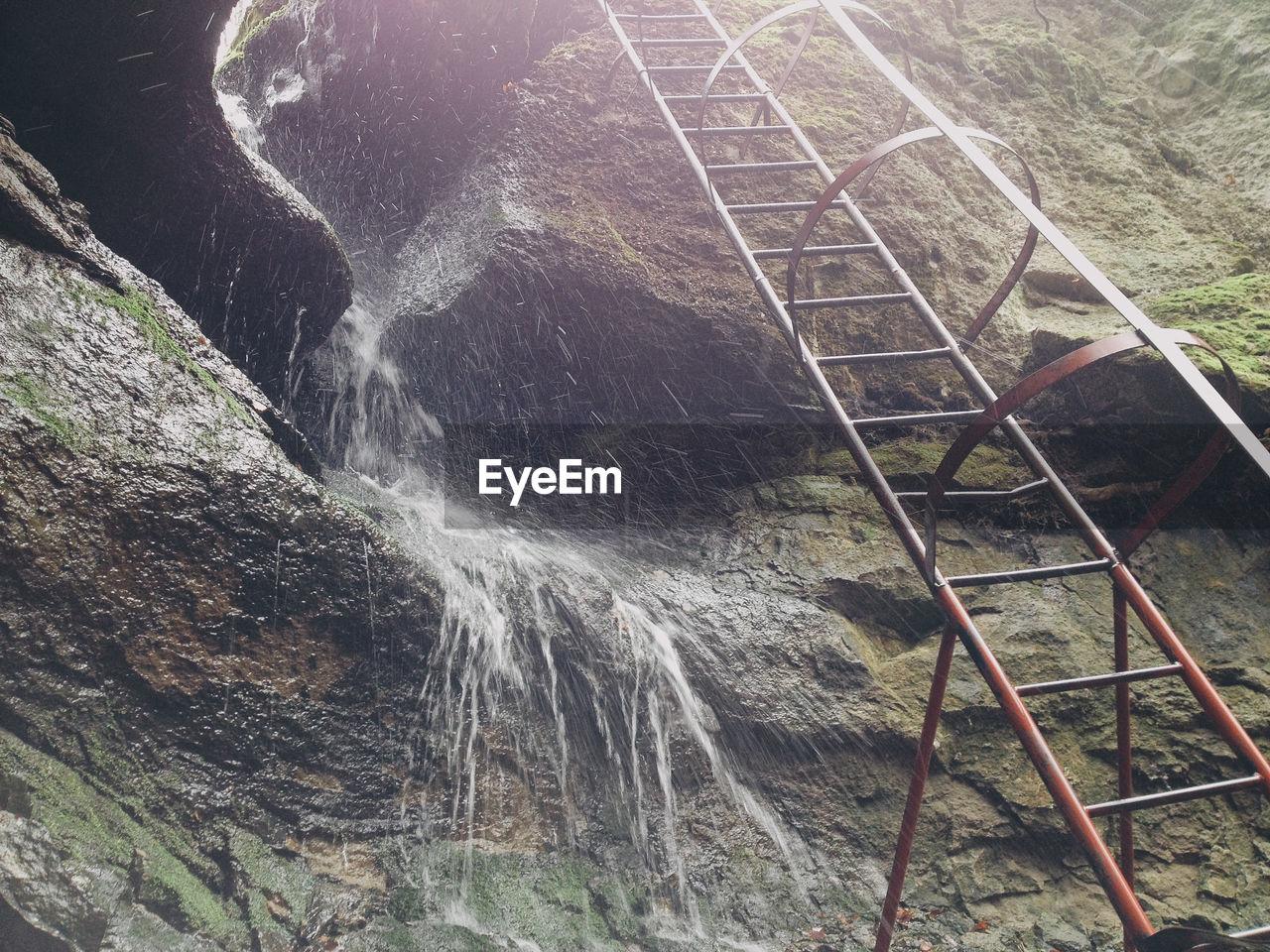 Metallic ladder by mountain