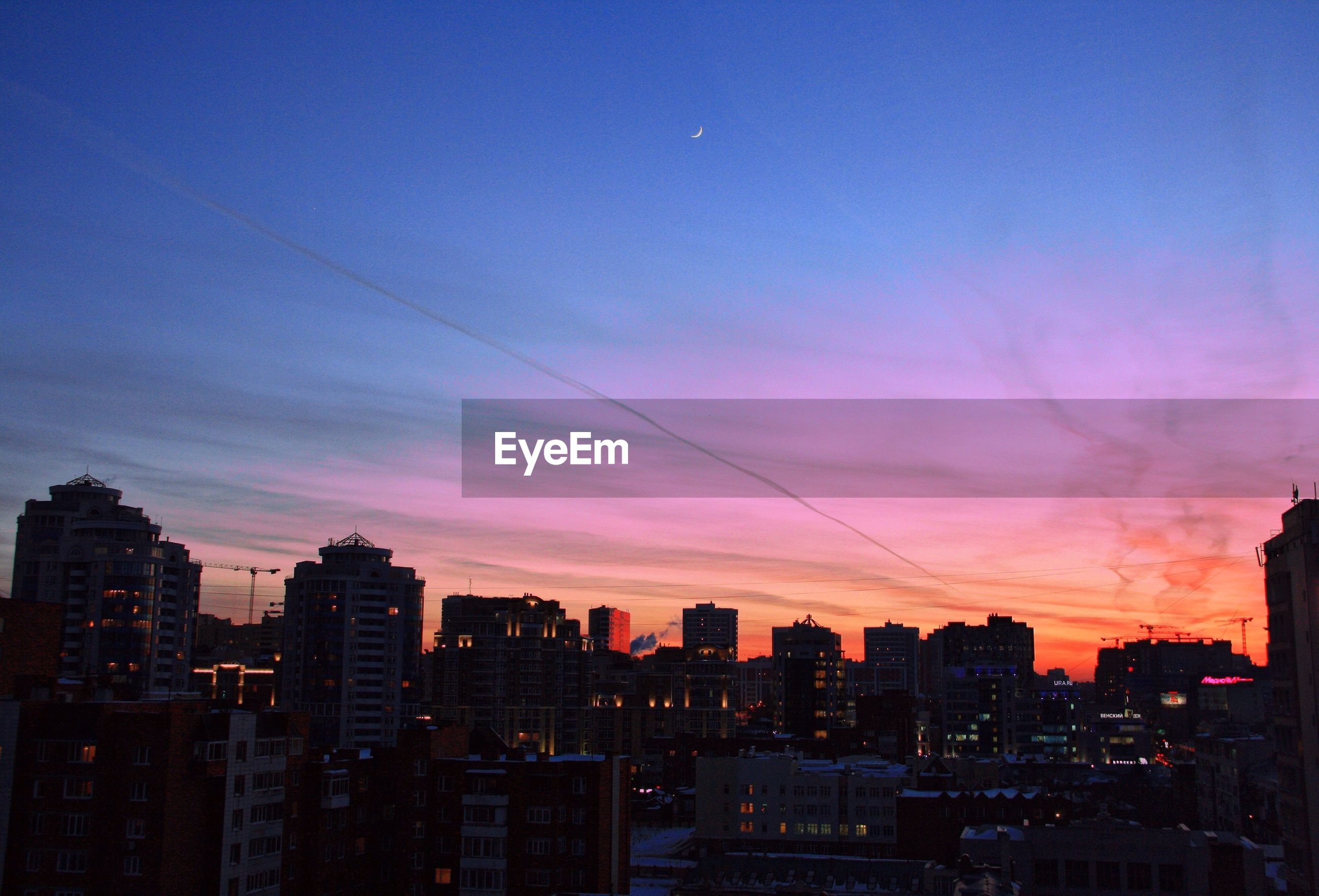 building exterior, city, sunset, architecture, built structure, cityscape, sky, silhouette, orange color, dusk, cloud - sky, skyscraper, city life, residential building, urban skyline, residential district, outdoors, no people, illuminated, cloud