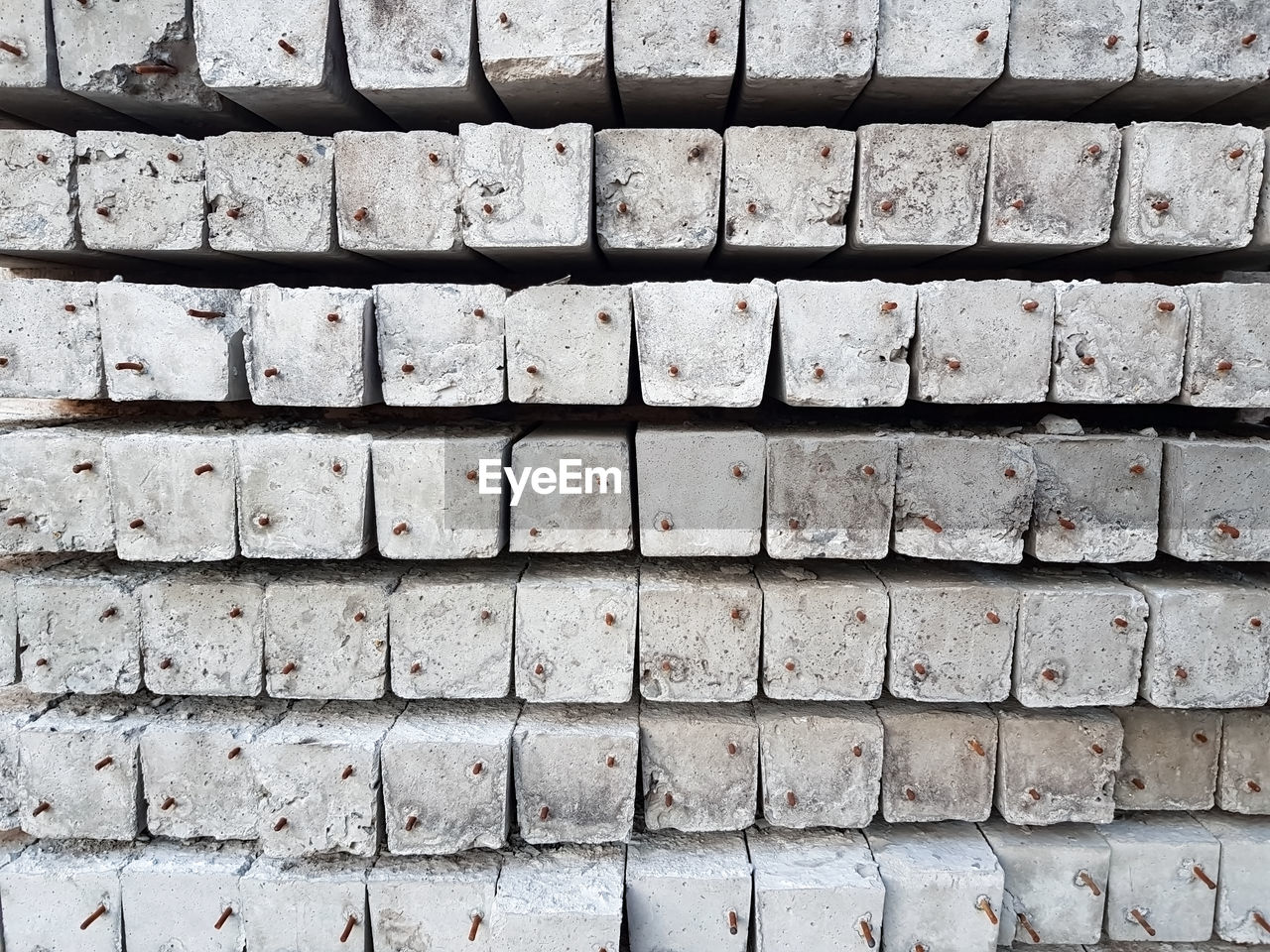 backgrounds, full frame, pattern, wall - building feature, no people, textured, repetition, wall, day, built structure, architecture, close-up, brick, brick wall, outdoors, in a row, gray, rough, arrangement, stone material, concrete