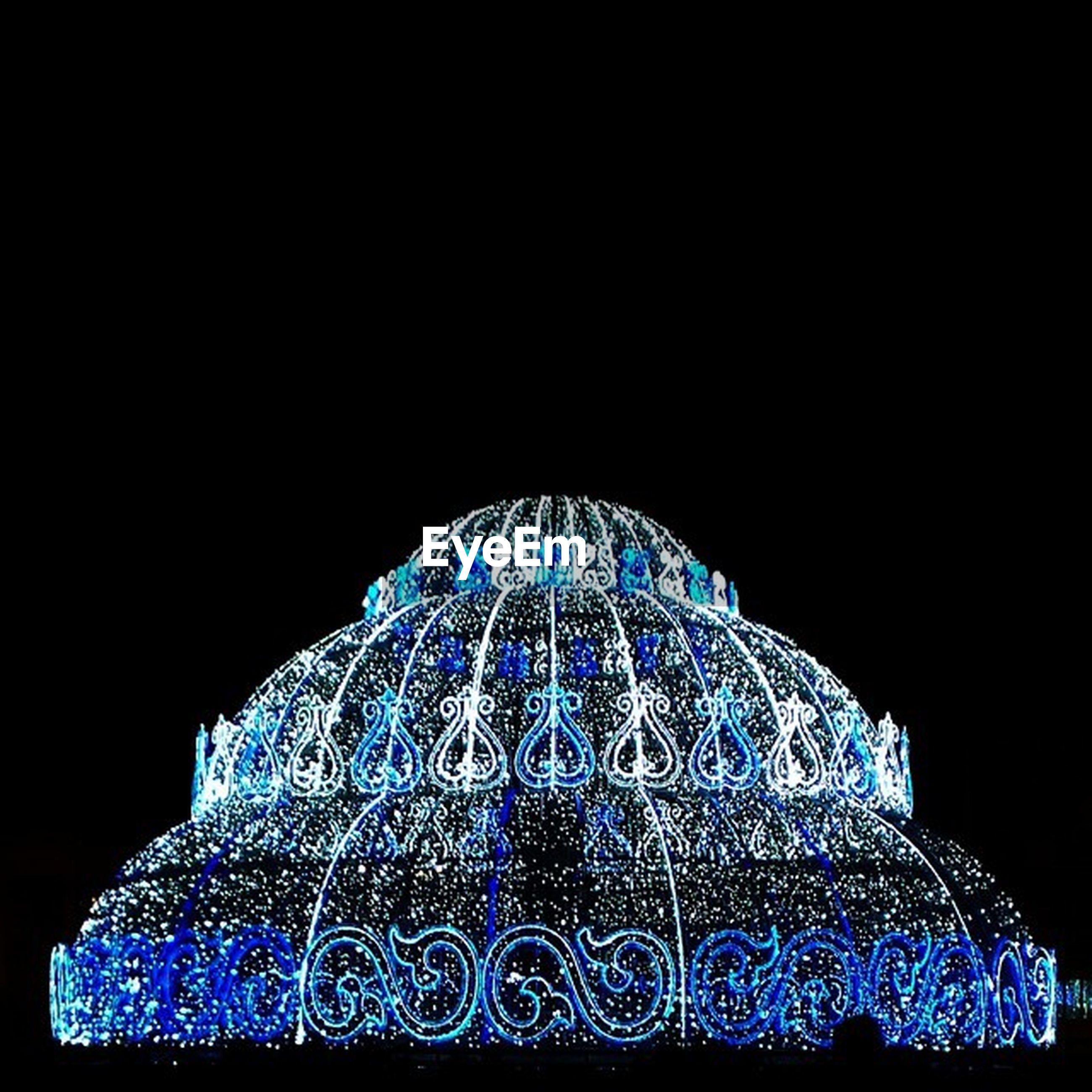 illuminated, night, blue, copy space, low angle view, black background, clear sky, religion, dome, famous place, studio shot, architecture, pattern, spirituality, built structure, international landmark, no people, travel destinations, place of worship