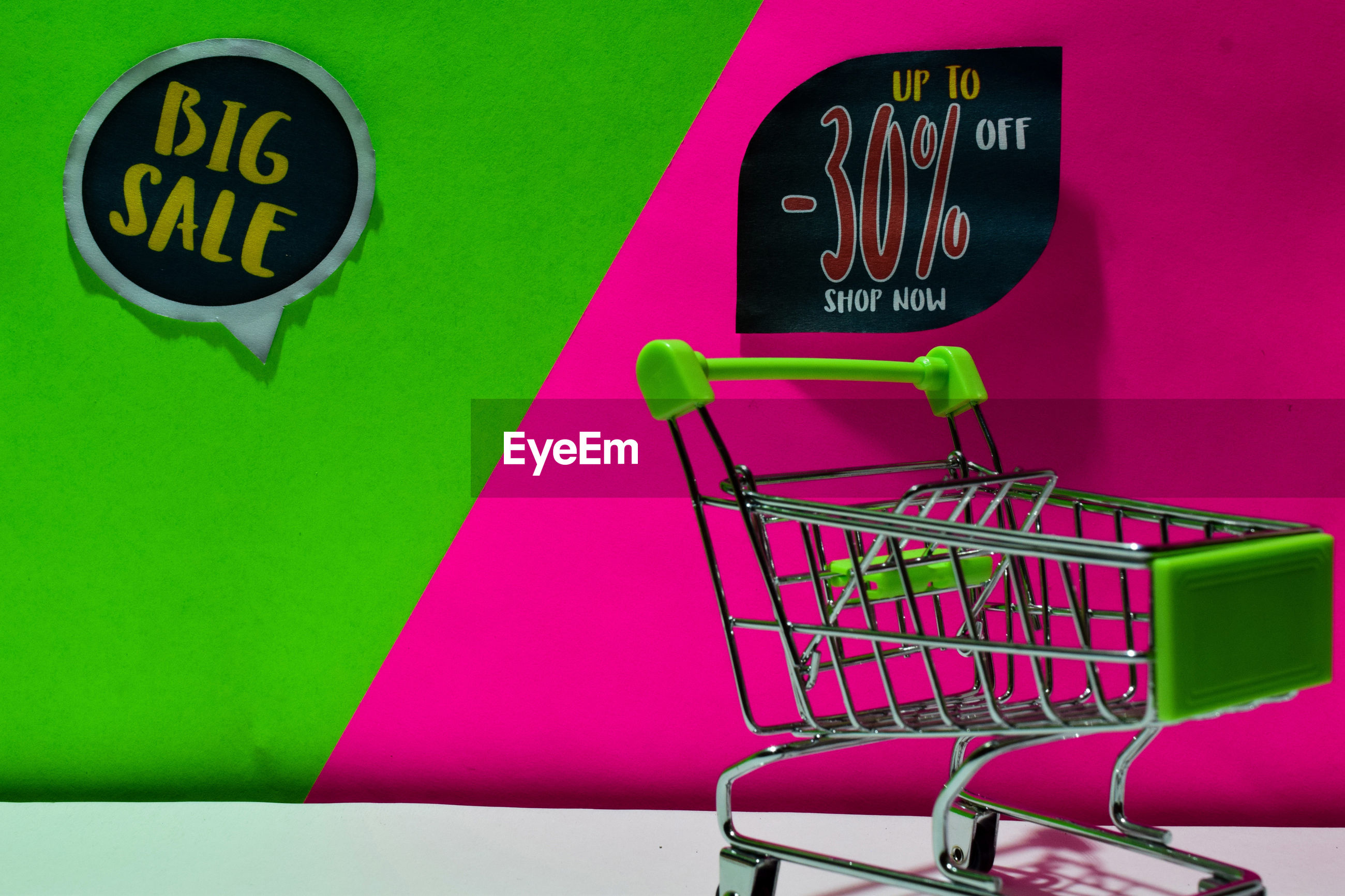 Close-up of small shopping cart with text