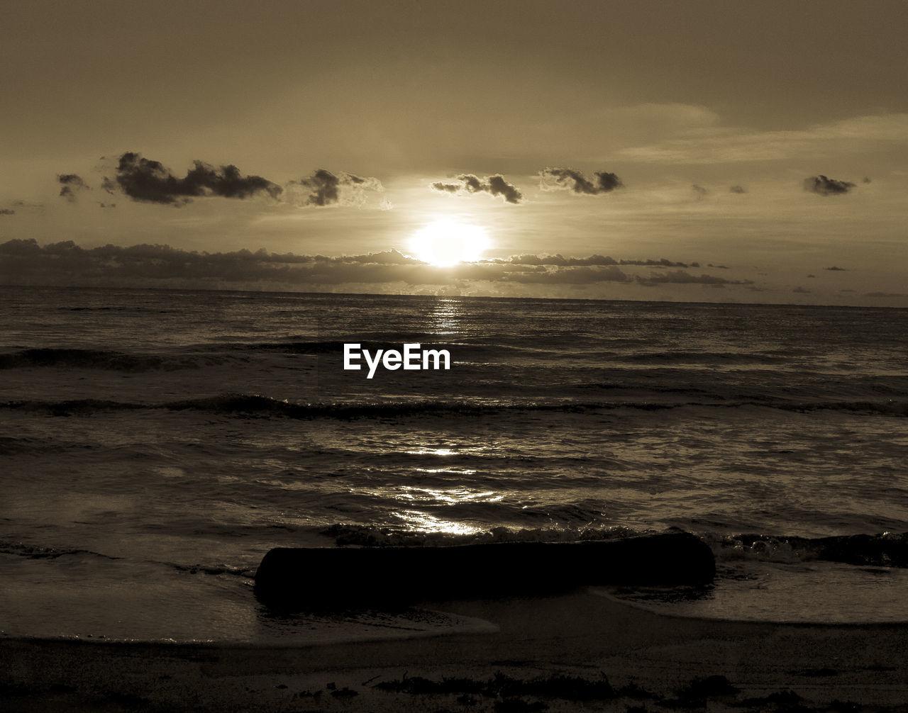 sea, sky, water, scenics - nature, sunset, beauty in nature, horizon over water, beach, land, horizon, cloud - sky, tranquil scene, tranquility, nature, no people, sun, idyllic, wave, sunlight, outdoors, bright