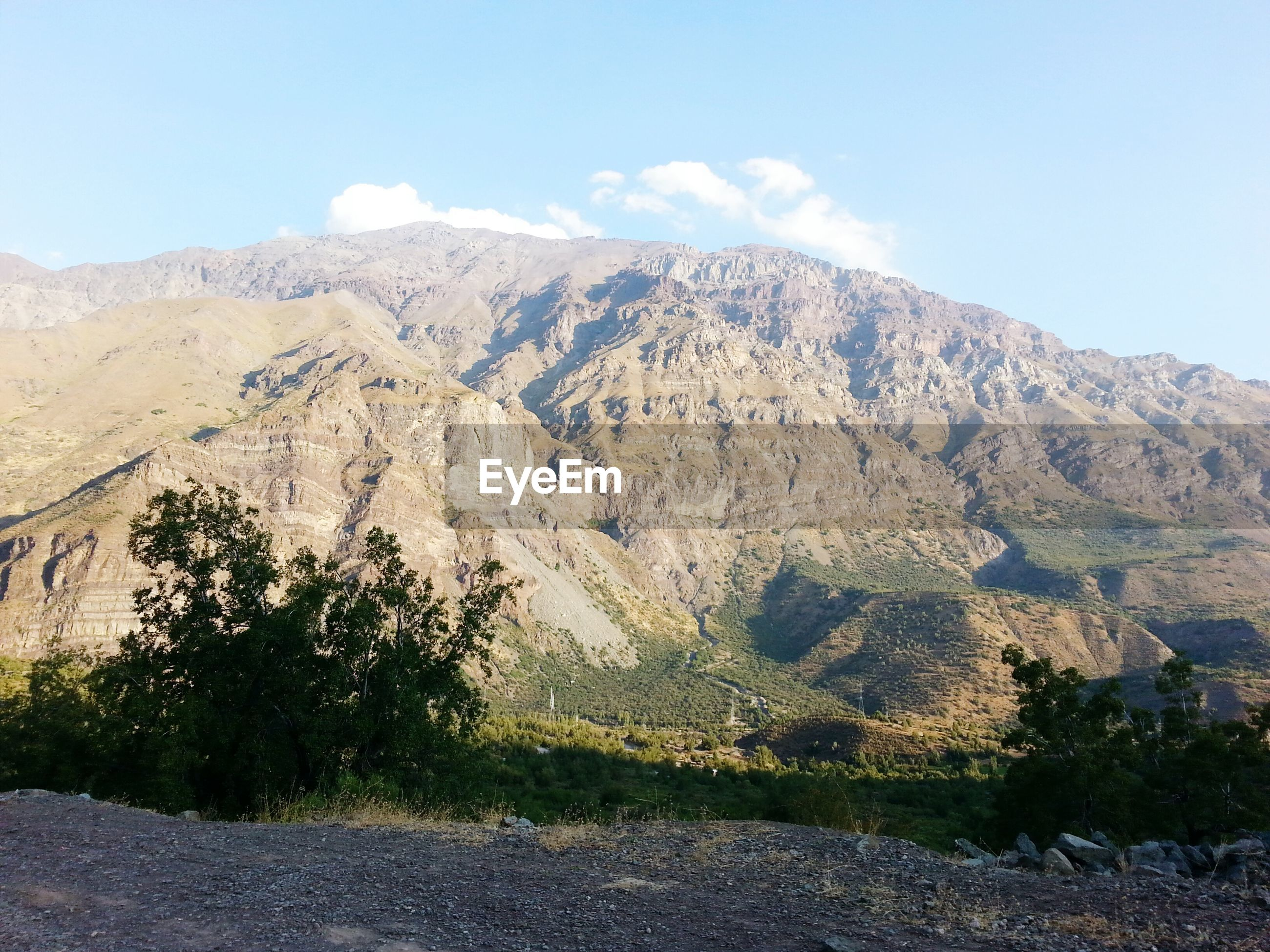 mountain, mountain range, tranquil scene, landscape, tranquility, scenics, sky, tree, beauty in nature, nature, non-urban scene, clear sky, remote, day, hill, rocky mountains, road, outdoors, physical geography, rock - object