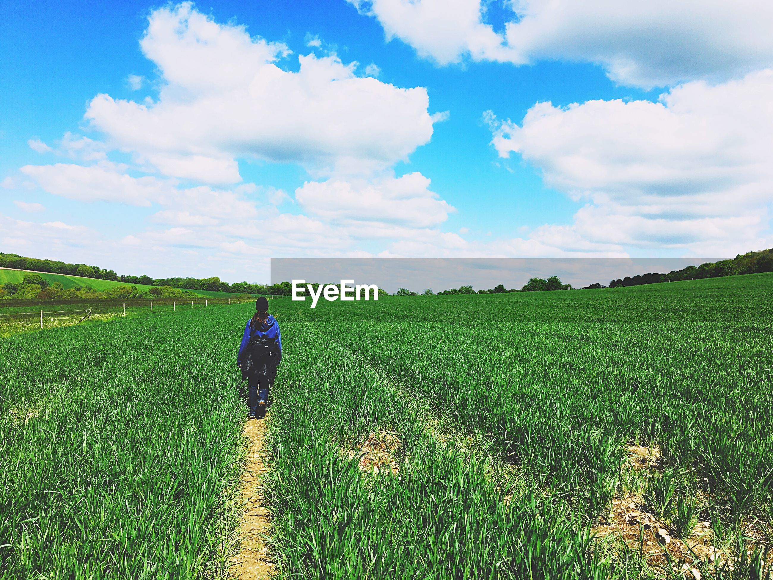 Woman walking on agricultural field