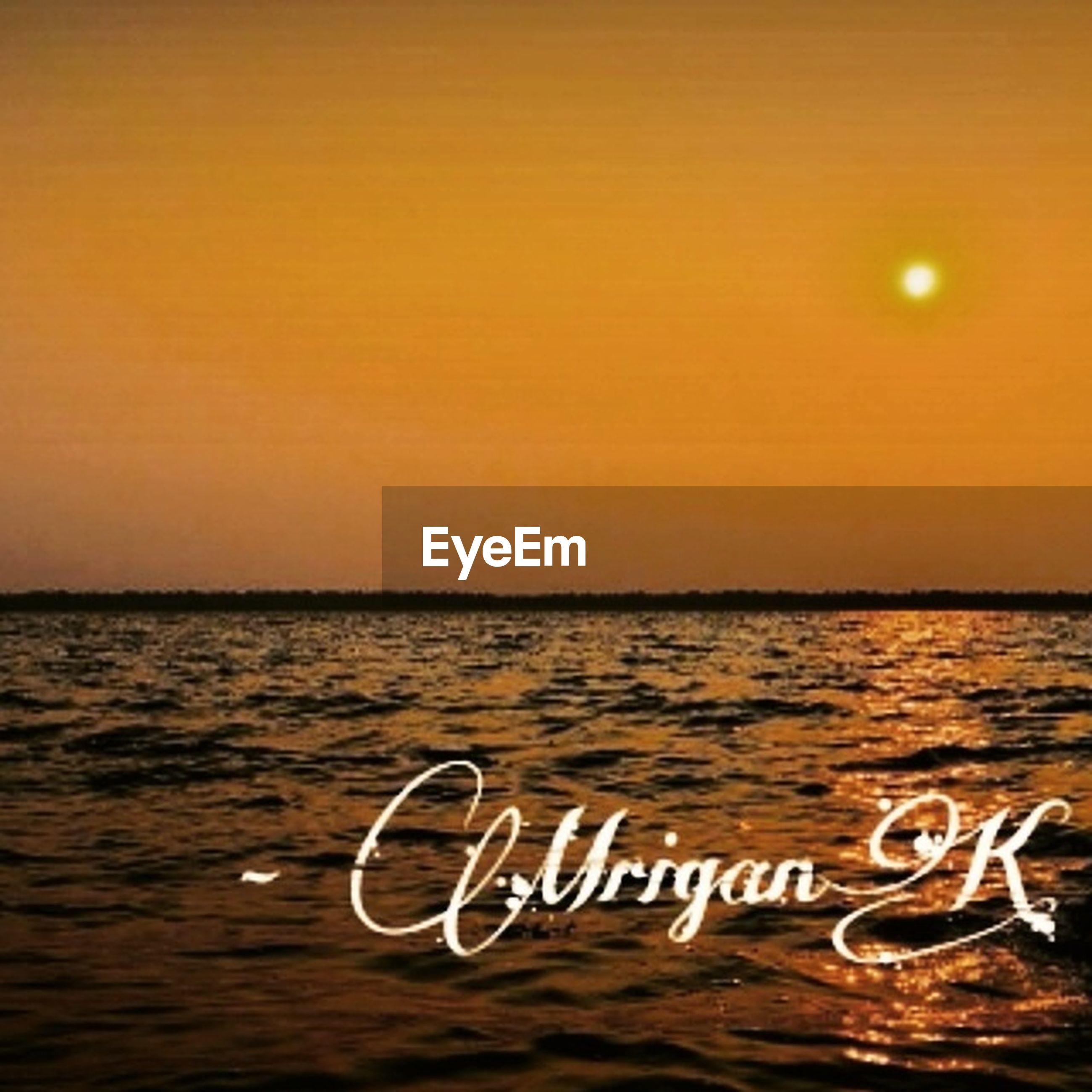 sea, water, sunset, text, horizon over water, western script, rippled, tranquil scene, scenics, communication, waterfront, tranquility, transportation, orange color, beauty in nature, beach, nature, wave, sky, clear sky