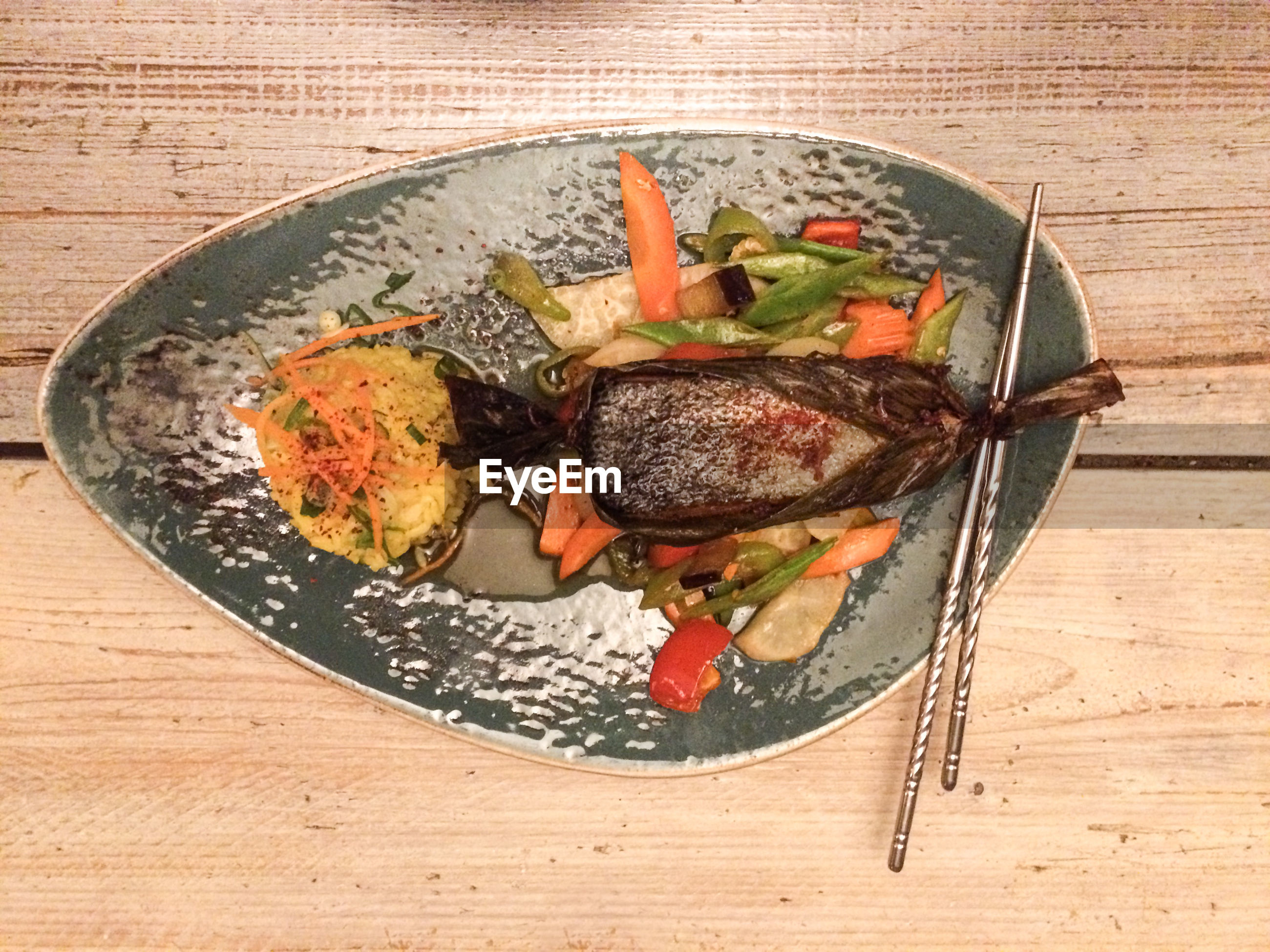 High angle view of seafood and rice served in plate on table