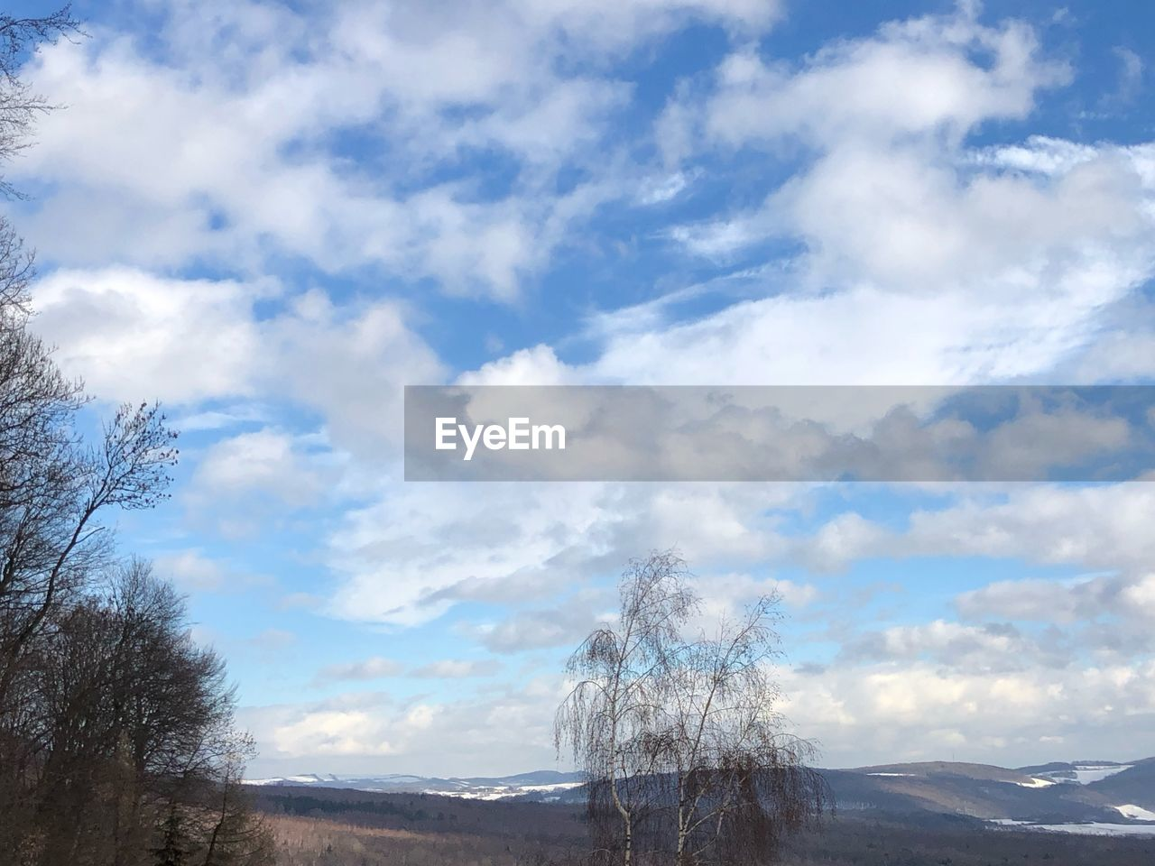 cloud - sky, sky, beauty in nature, scenics - nature, tranquility, tranquil scene, mountain, nature, non-urban scene, no people, day, environment, landscape, tree, outdoors, idyllic, plant, low angle view, cold temperature, mountain peak