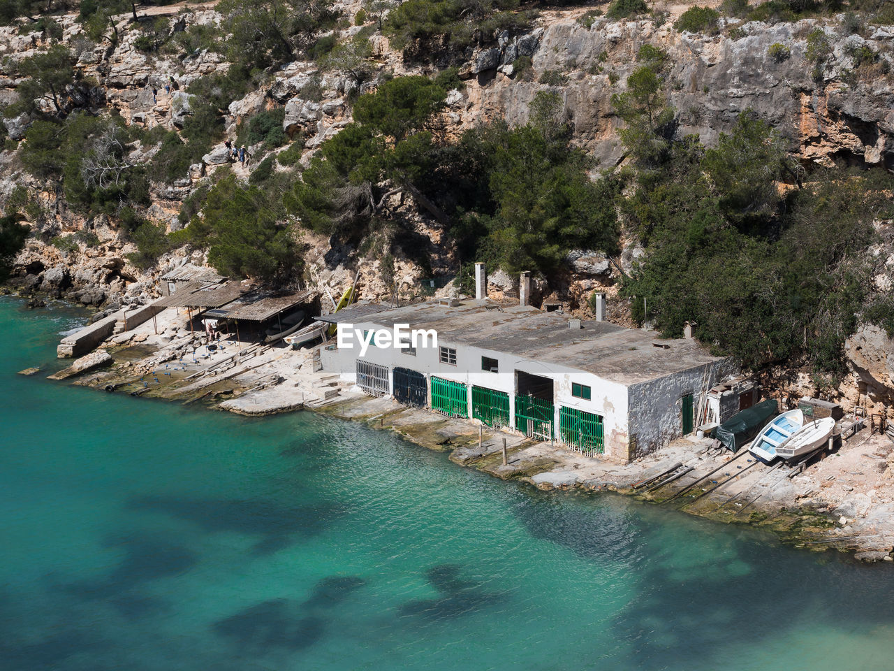 water, nature, day, architecture, high angle view, built structure, tree, travel, no people, waterfront, fuel and power generation, solid, travel destinations, plant, rock, rock - object, mountain, land, scenics - nature, outdoors, turquoise colored, swimming pool