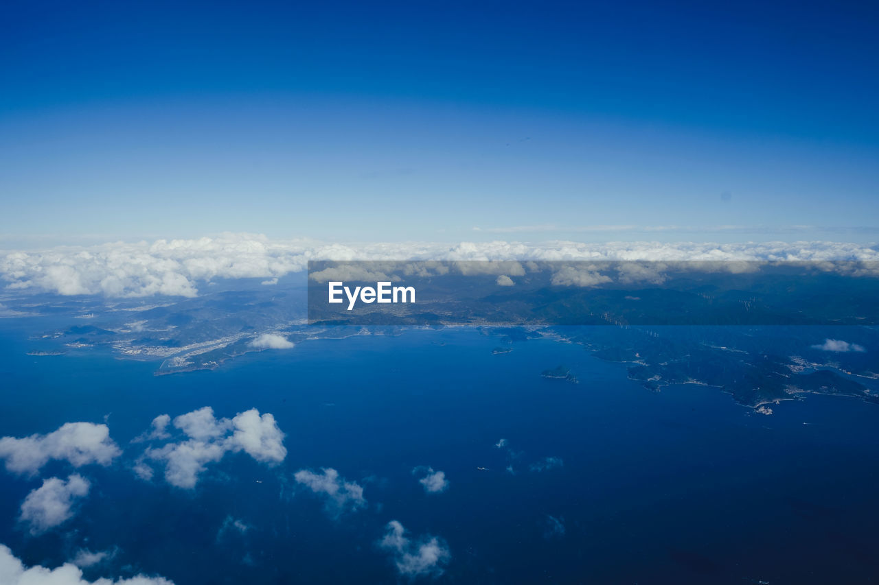 sky, cloud - sky, beauty in nature, blue, scenics - nature, aerial view, tranquil scene, tranquility, no people, nature, environment, outdoors, idyllic, day, copy space, white color, water, sea, cloudscape, meteorology, view into land, above