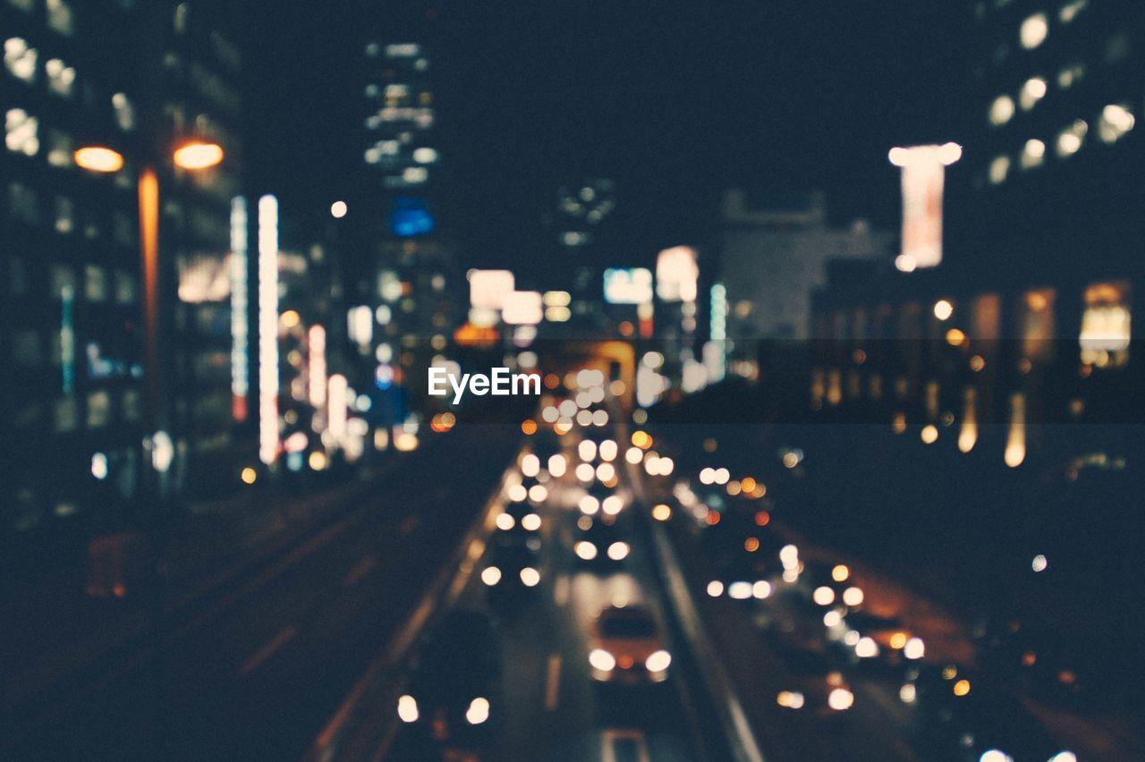 Defocused Image Of City Traffic By Night