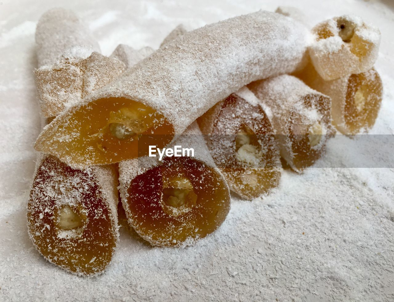 food, food and drink, indoors, freshness, still life, no people, close-up, sweet food, sugar, powdered sugar, high angle view, flour, indulgence, focus on foreground, winter, ready-to-eat, sweet, cold temperature, snow, healthy eating, temptation