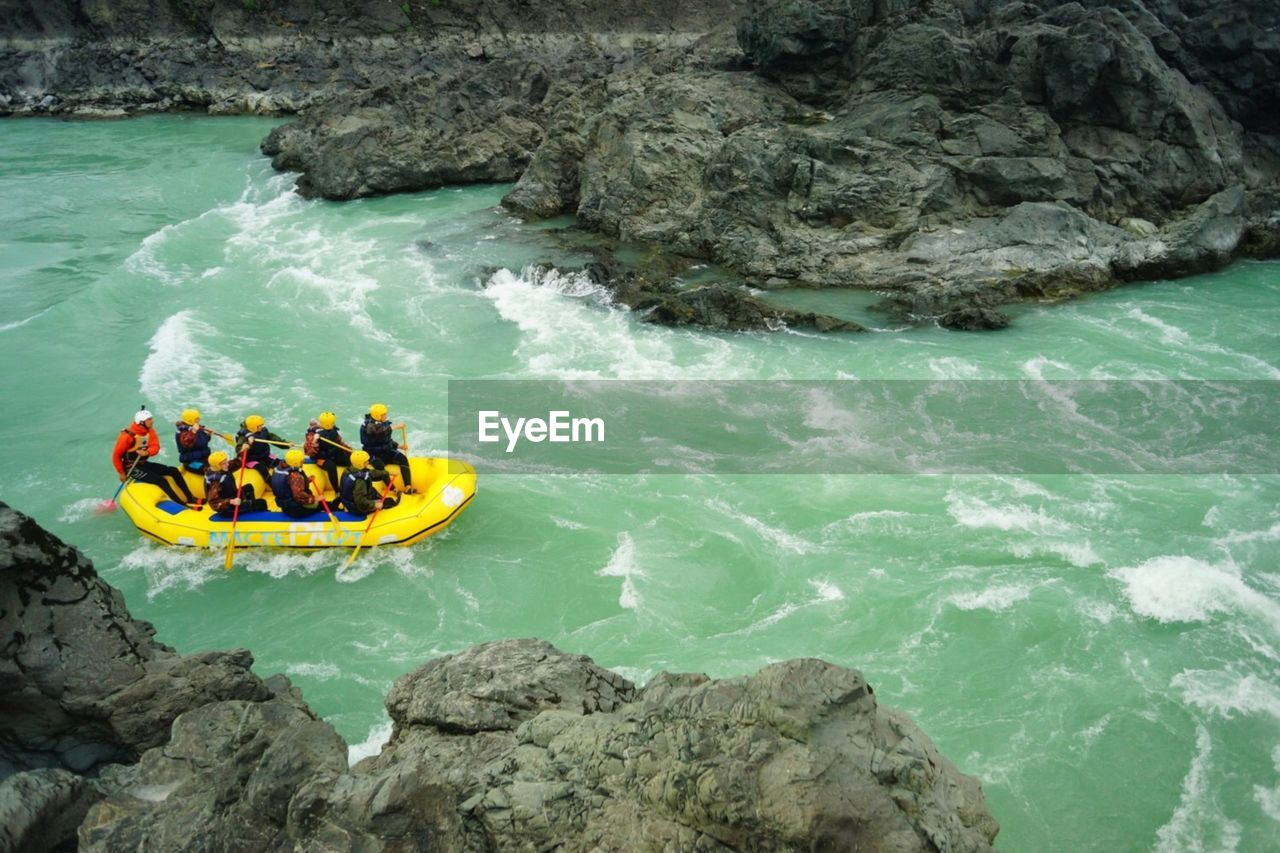 High angle view of people in raft on river