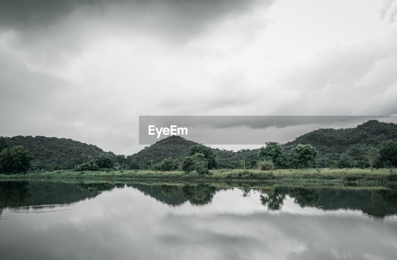sky, cloud - sky, tranquility, tranquil scene, water, beauty in nature, reflection, scenics - nature, lake, tree, nature, plant, day, waterfront, no people, non-urban scene, idyllic, green color, outdoors