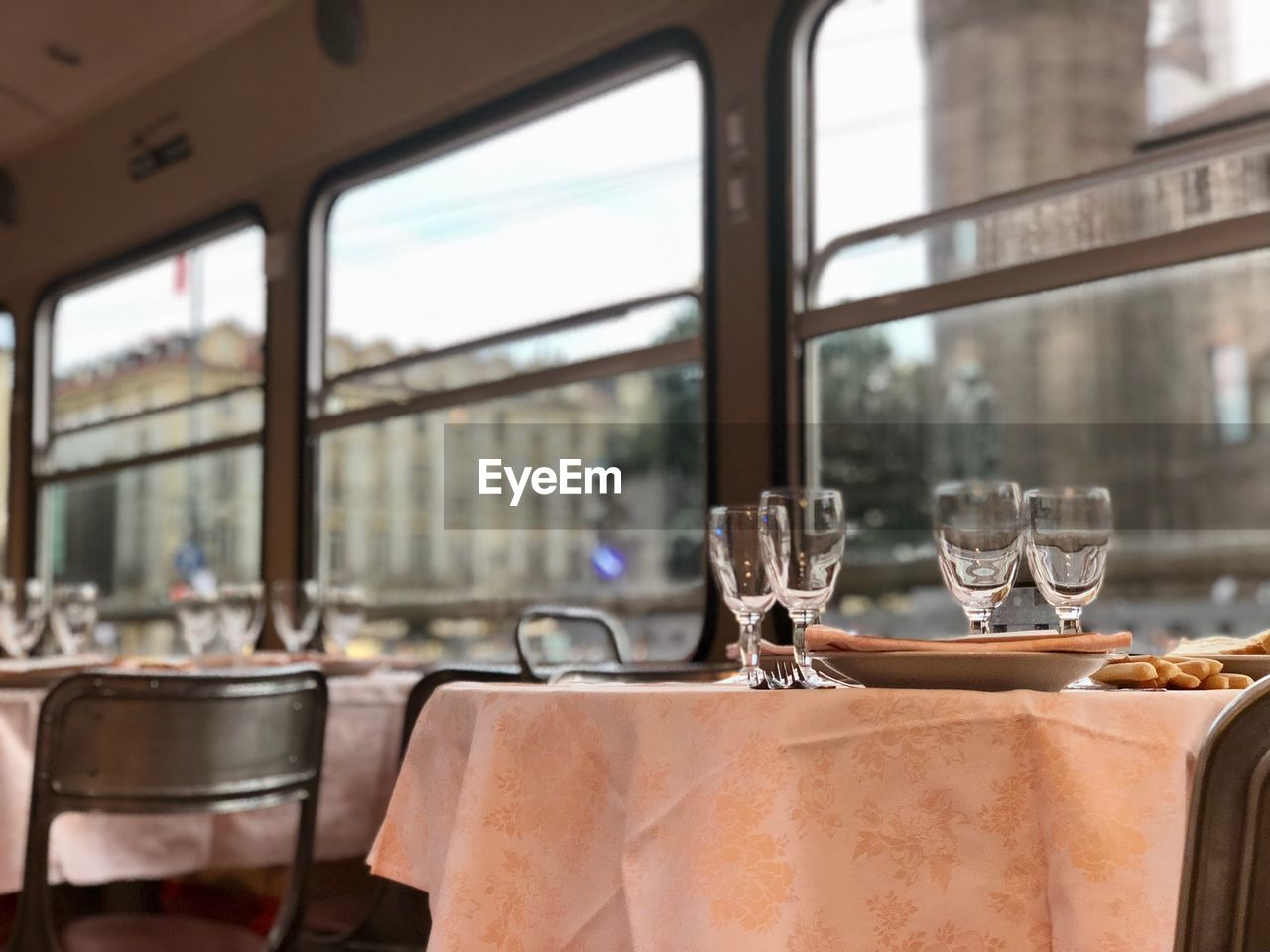Close-up of dining table by window in restaurant