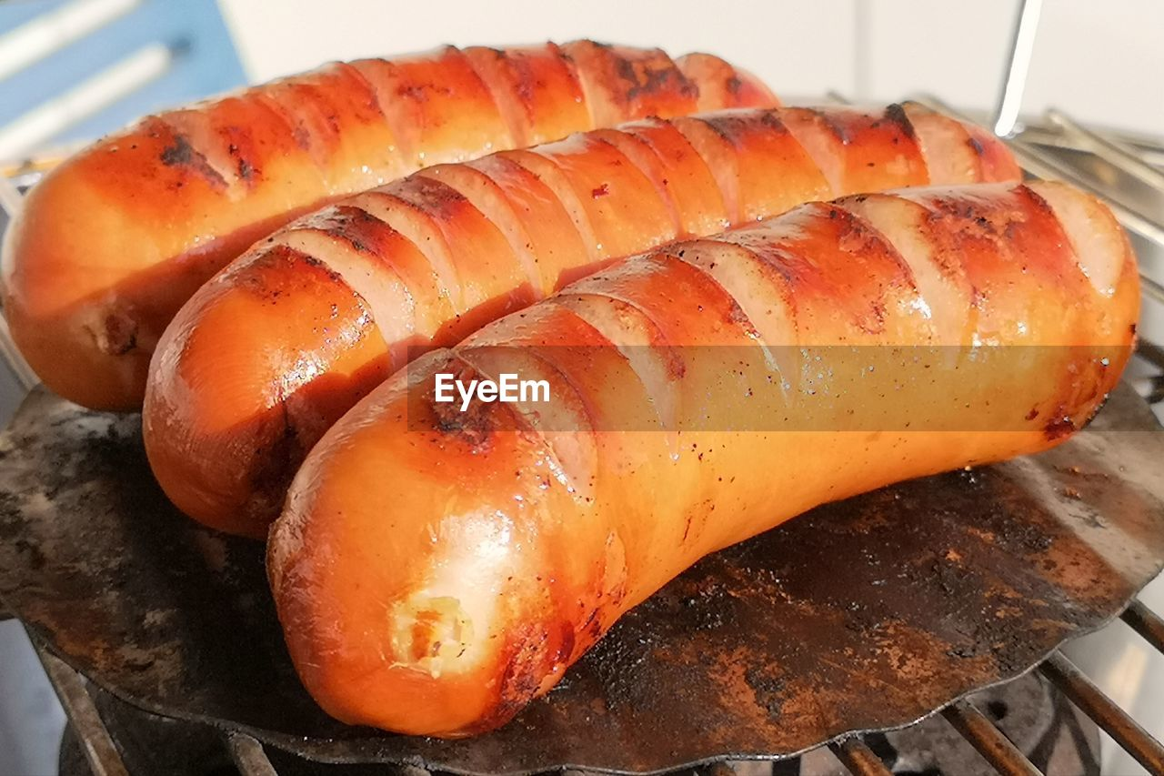 food and drink, food, freshness, healthy eating, wellbeing, close-up, no people, high angle view, still life, orange color, seafood, indoors, heat - temperature, focus on foreground, ready-to-eat, barbecue, kitchen utensil, household equipment, meat, preparation, tray