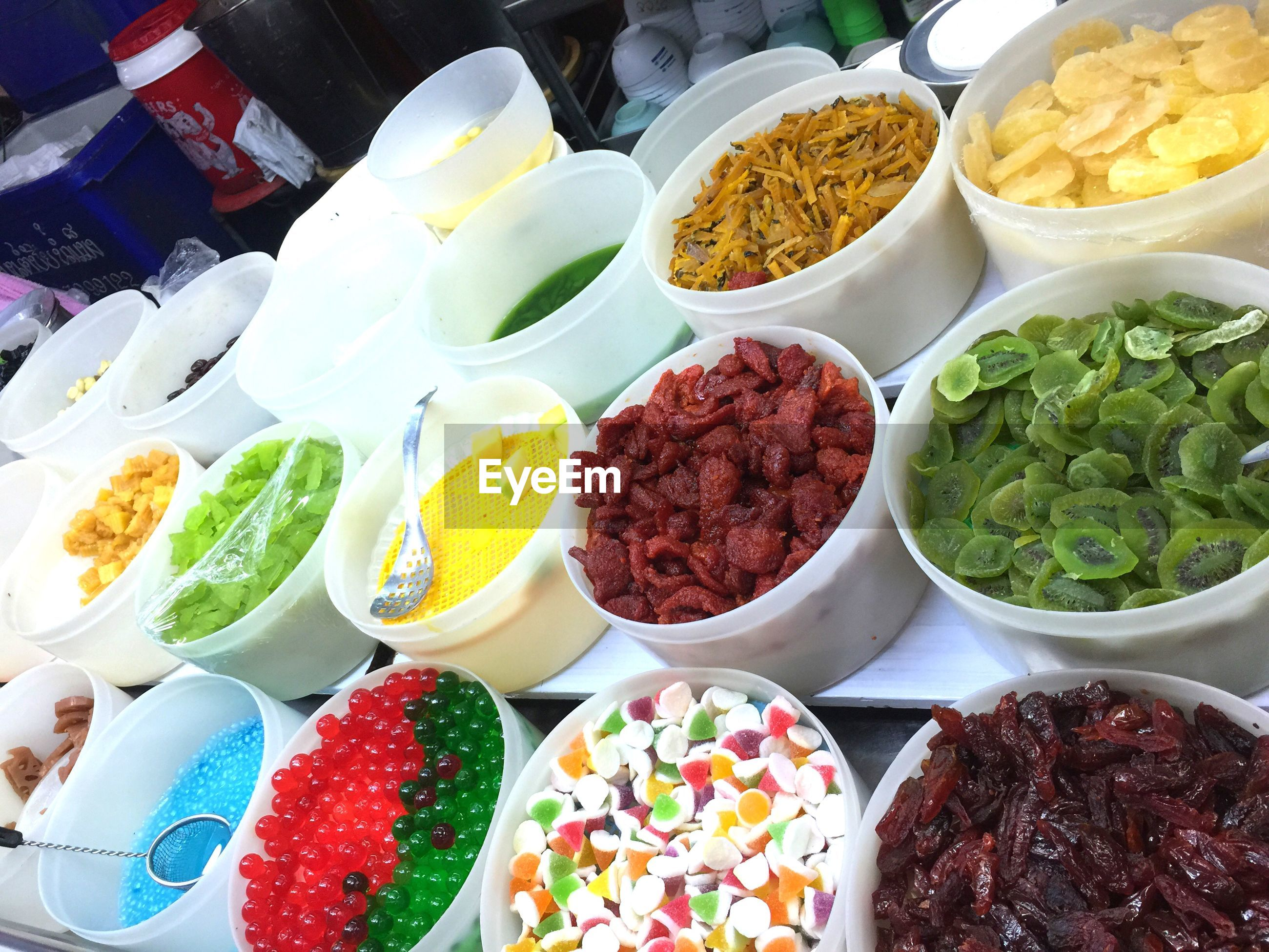 High angle view of food variation in containers at market stall