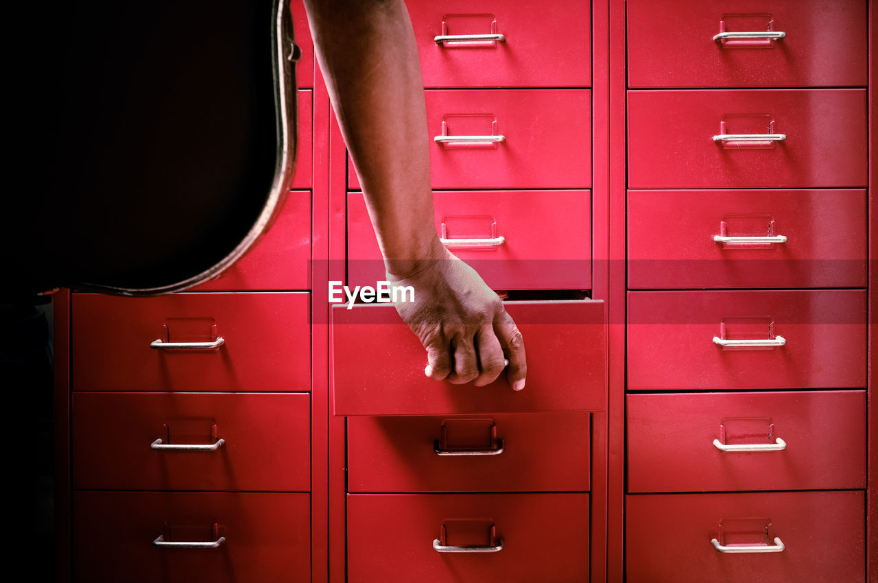 Cropped Hand Opening Drawer