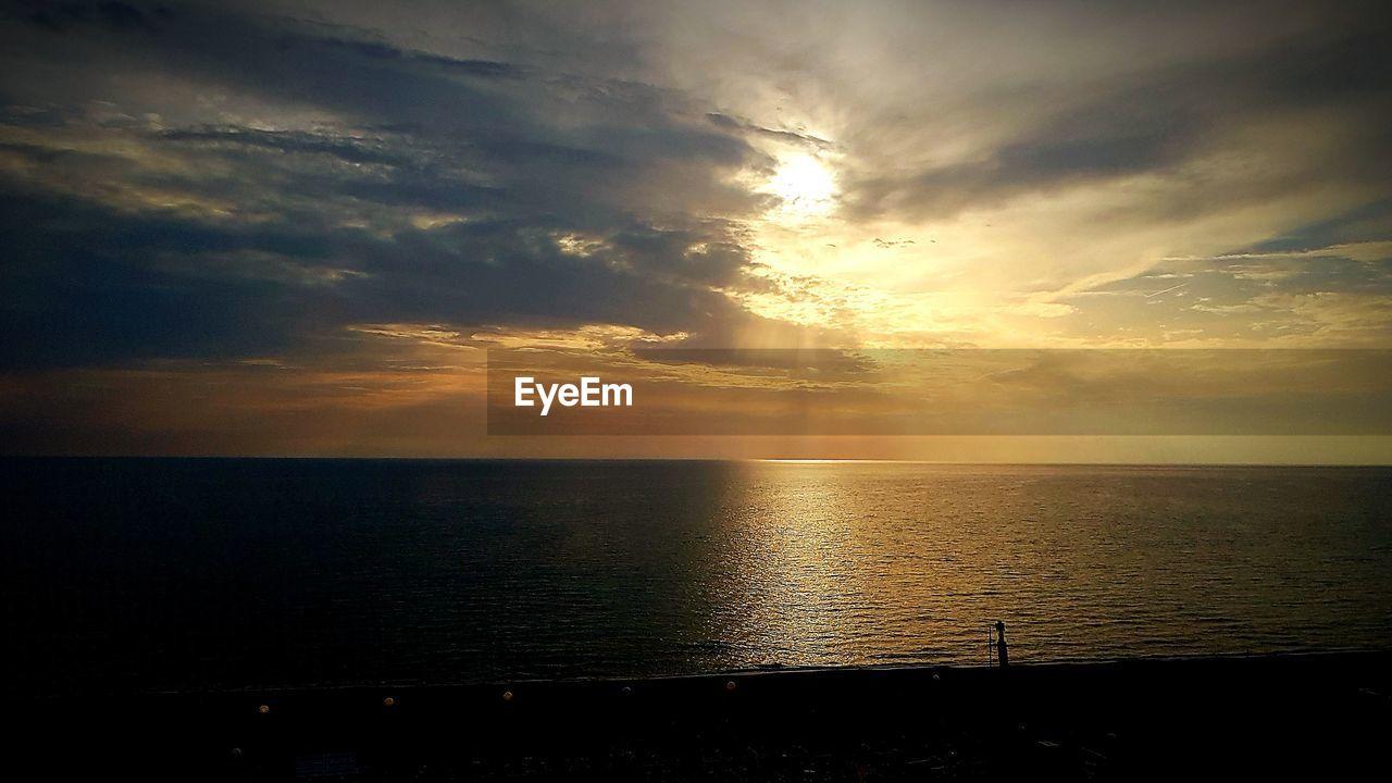 sky, water, cloud - sky, scenics - nature, beauty in nature, sea, sunset, tranquility, tranquil scene, horizon, horizon over water, nature, idyllic, no people, sunlight, sunbeam, sun, reflection, non-urban scene, outdoors