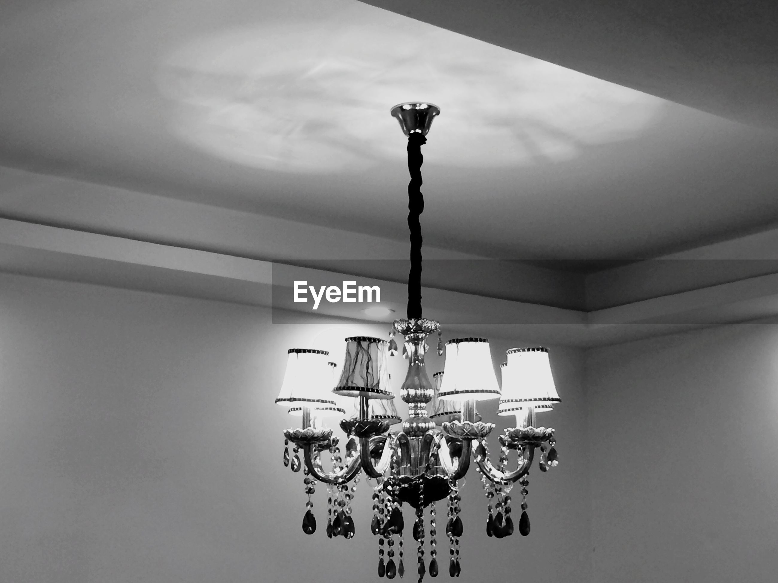 low angle view, indoors, hanging, lighting equipment, ceiling, sky, decoration, built structure, electric lamp, illuminated, architecture, electric light, electricity, no people, day, art and craft, chandelier, lantern, cloud - sky, light bulb