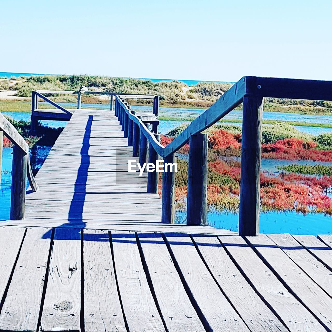 railing, day, outdoors, clear sky, no people, wood - material, beach, sea, water, blue, sky, horizon over water, nature