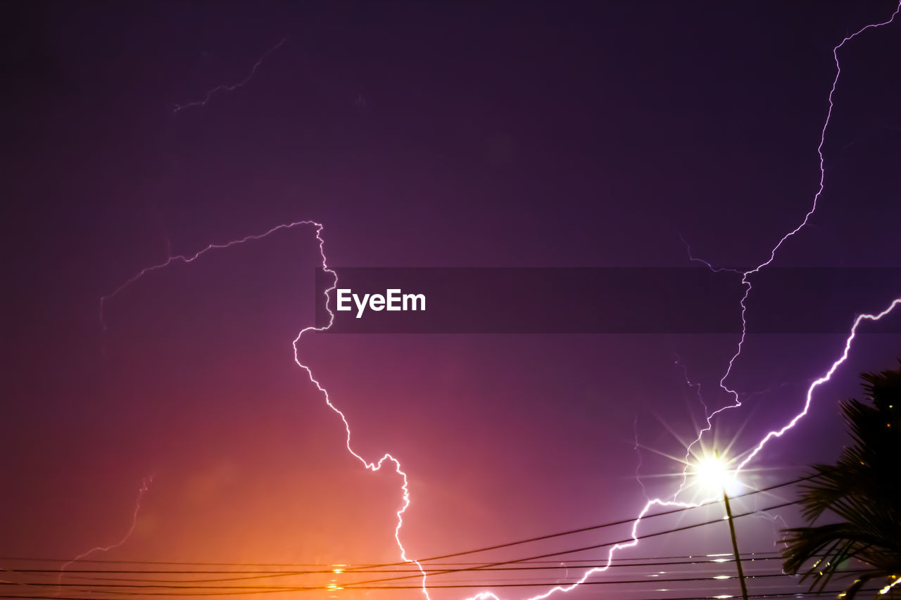 lightning, storm, power in nature, cloud - sky, power, sky, thunderstorm, beauty in nature, forked lightning, electricity, nature, dramatic sky, no people, night, low angle view, illuminated, atmospheric mood, storm cloud, warning sign, outdoors, light, extreme weather, purple