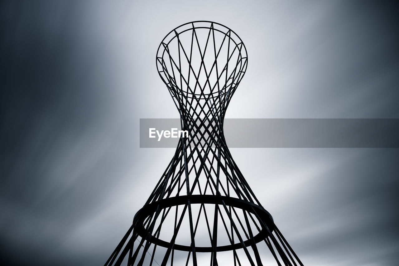 sky, no people, metal, pattern, nature, day, low angle view, design, shape, close-up, outdoors, architecture, silhouette, built structure, geometric shape, cloud - sky, art and craft, creativity, circle, vignette, directly below
