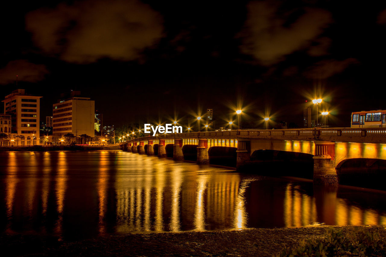 illuminated, water, architecture, night, built structure, reflection, building exterior, bridge, city, river, connection, bridge - man made structure, transportation, waterfront, no people, nature, sky, building, street, outdoors, light