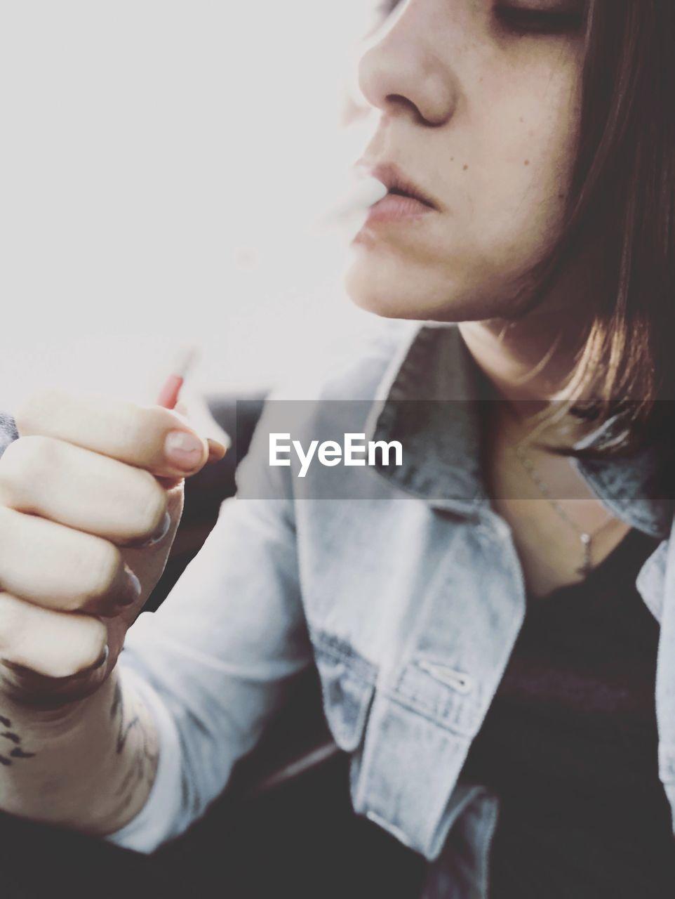 Close-Up Of Woman Smoking Electronic Cigarette