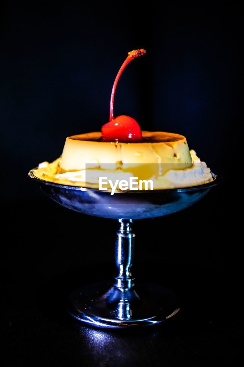 food and drink, food, freshness, indoors, indulgence, still life, black background, dessert, sweet food, no people, studio shot, sweet, healthy eating, fruit, close-up, ready-to-eat, table, cherry, red, temptation, glass