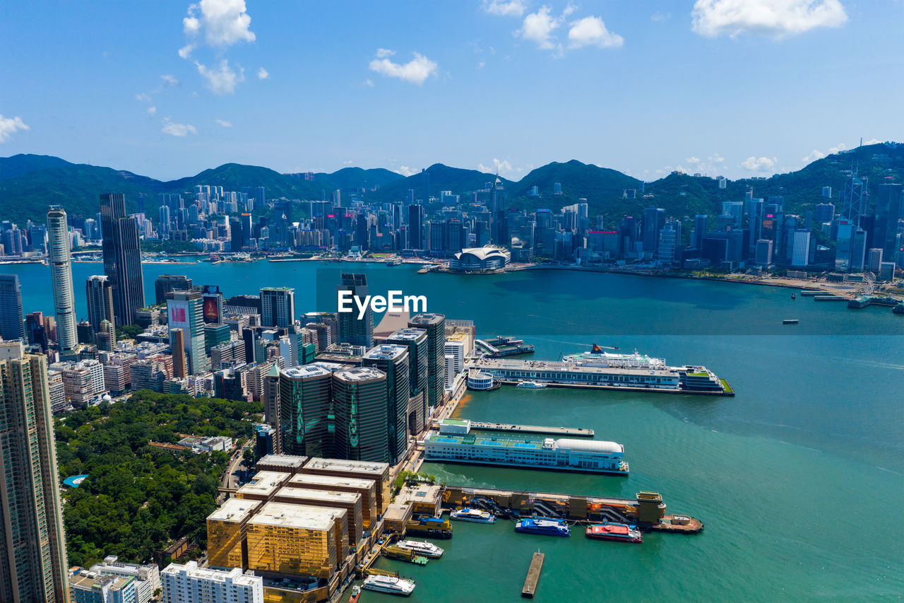 High angle view of bay and buildings against sky