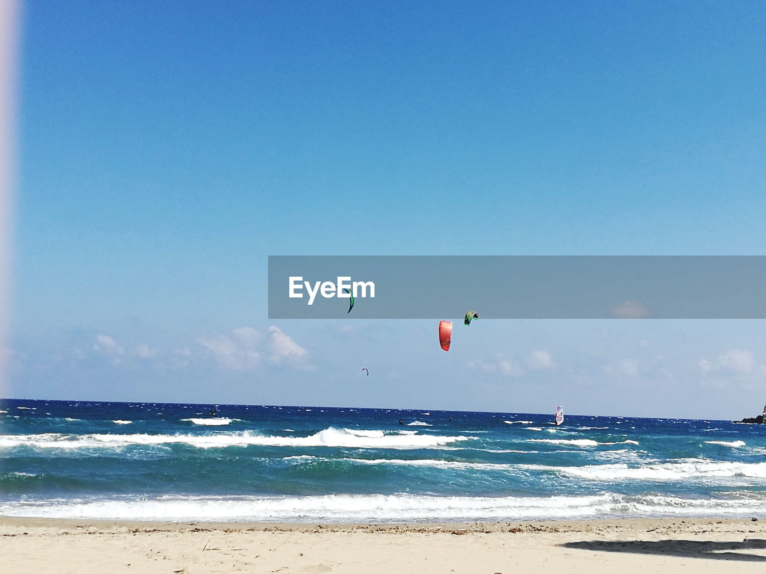 sea, flying, blue, beach, sky, water, beauty in nature, clear sky, nature, horizon over water, outdoors, day, parasailing, scenics, adventure, kiteboarding, no people, parachute, paragliding