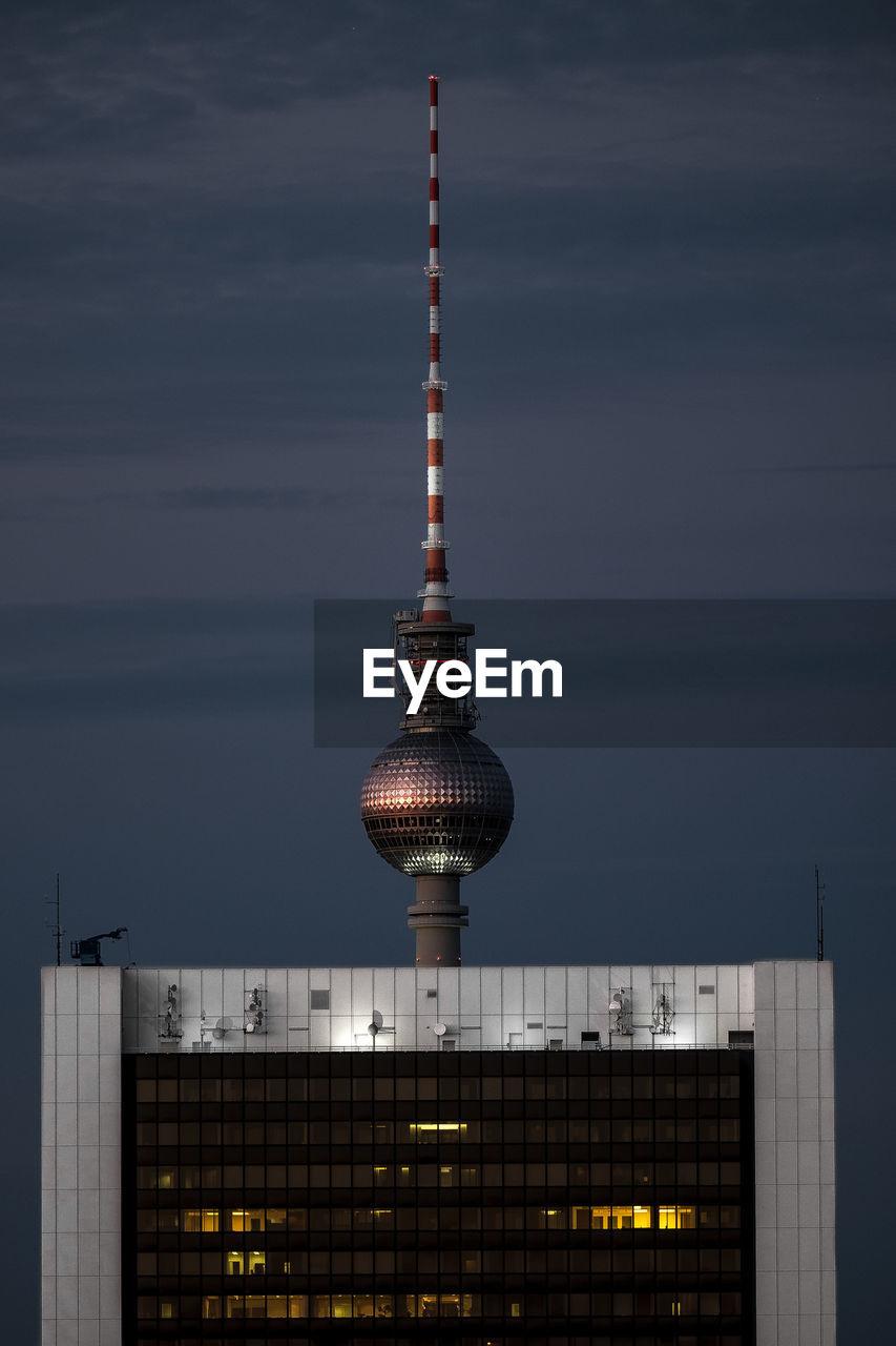 Fernsehturm against sky at night