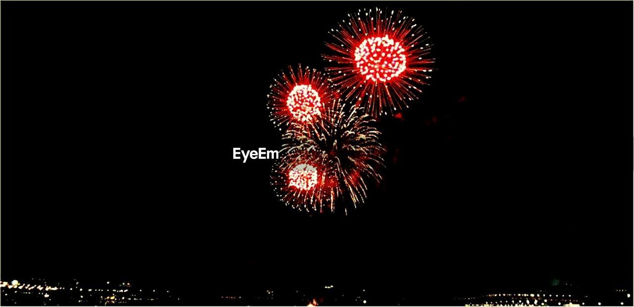 firework display, celebration, night, firework - man made object, exploding, arts culture and entertainment, long exposure, event, low angle view, illuminated, no people, motion, outdoors, sky