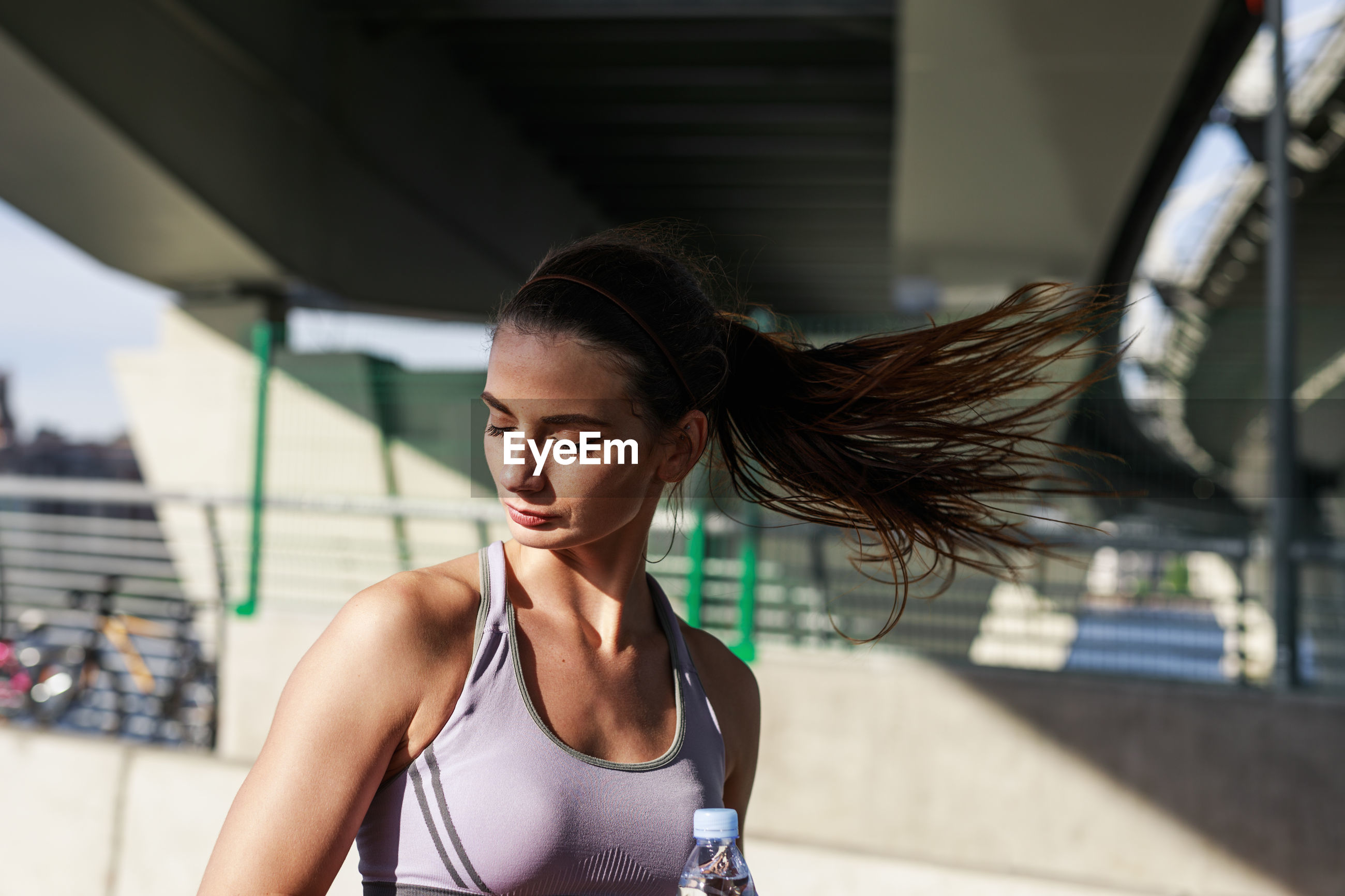 Close-up of young woman tossing hair