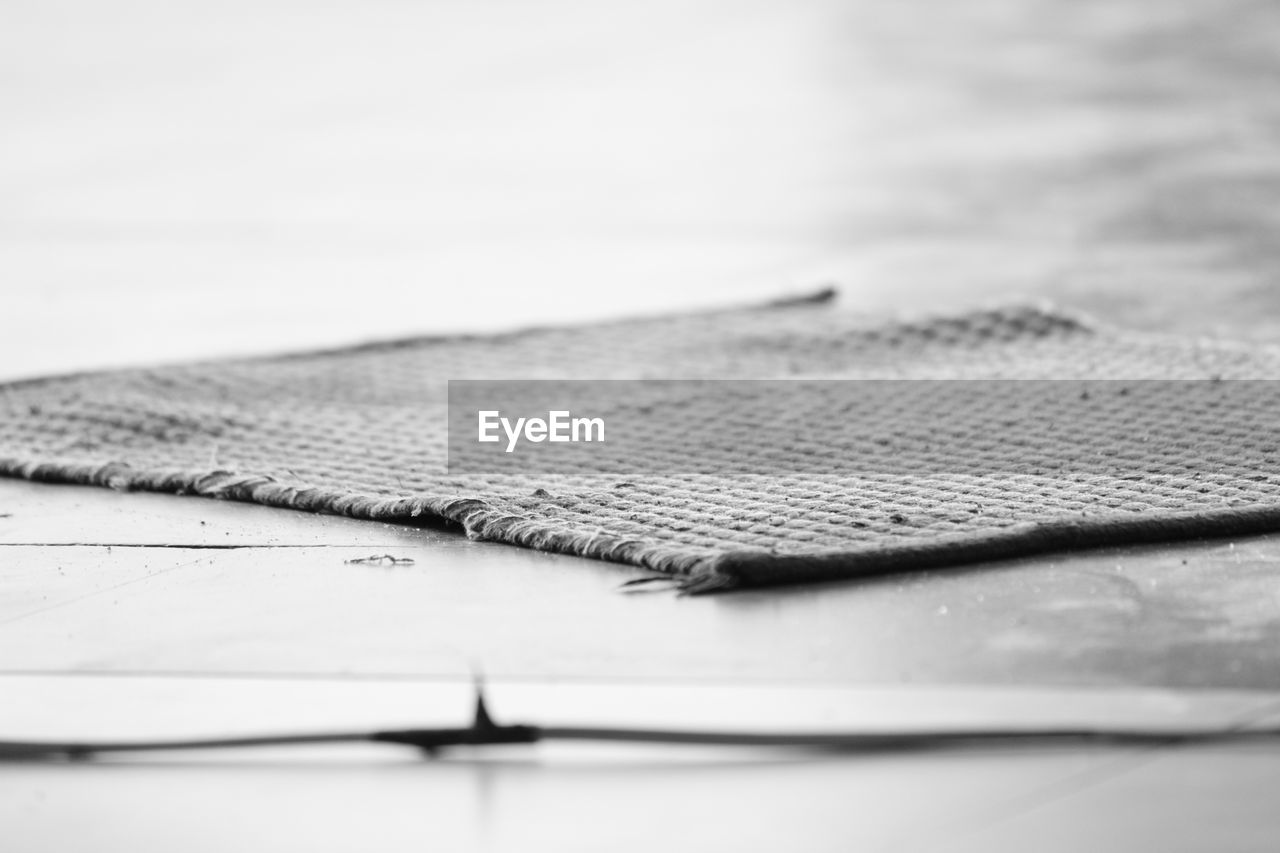 selective focus, no people, indoors, close-up, table, day