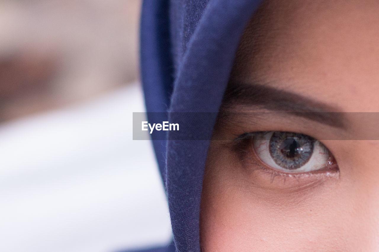 Cropped portrait of woman wearing lens