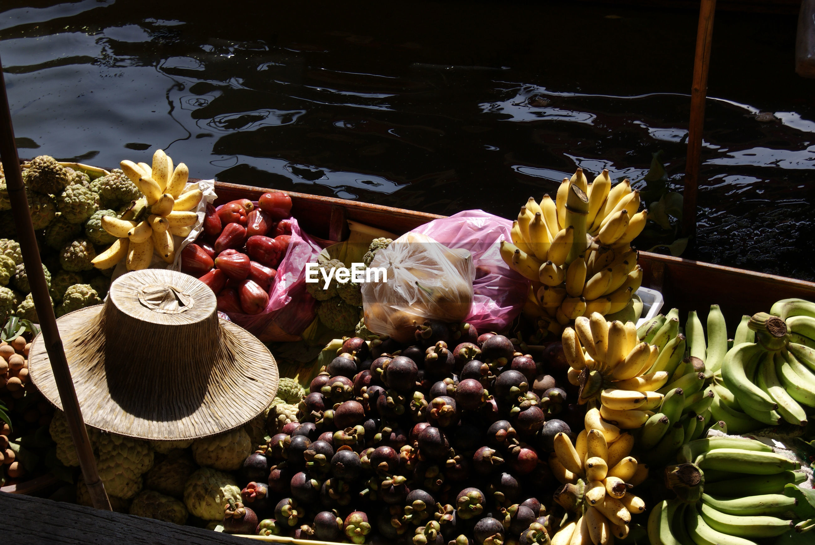 Fruits in boat on lake