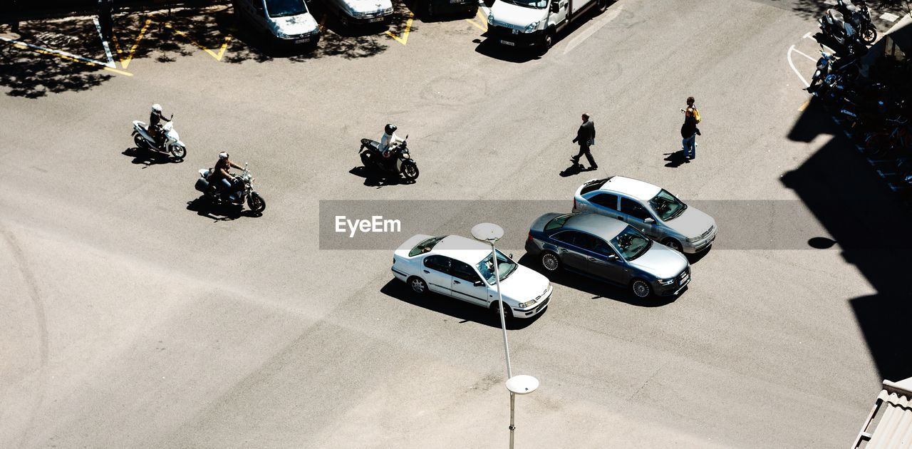 High Angle View Of Pedestrians And Vehicles On Street