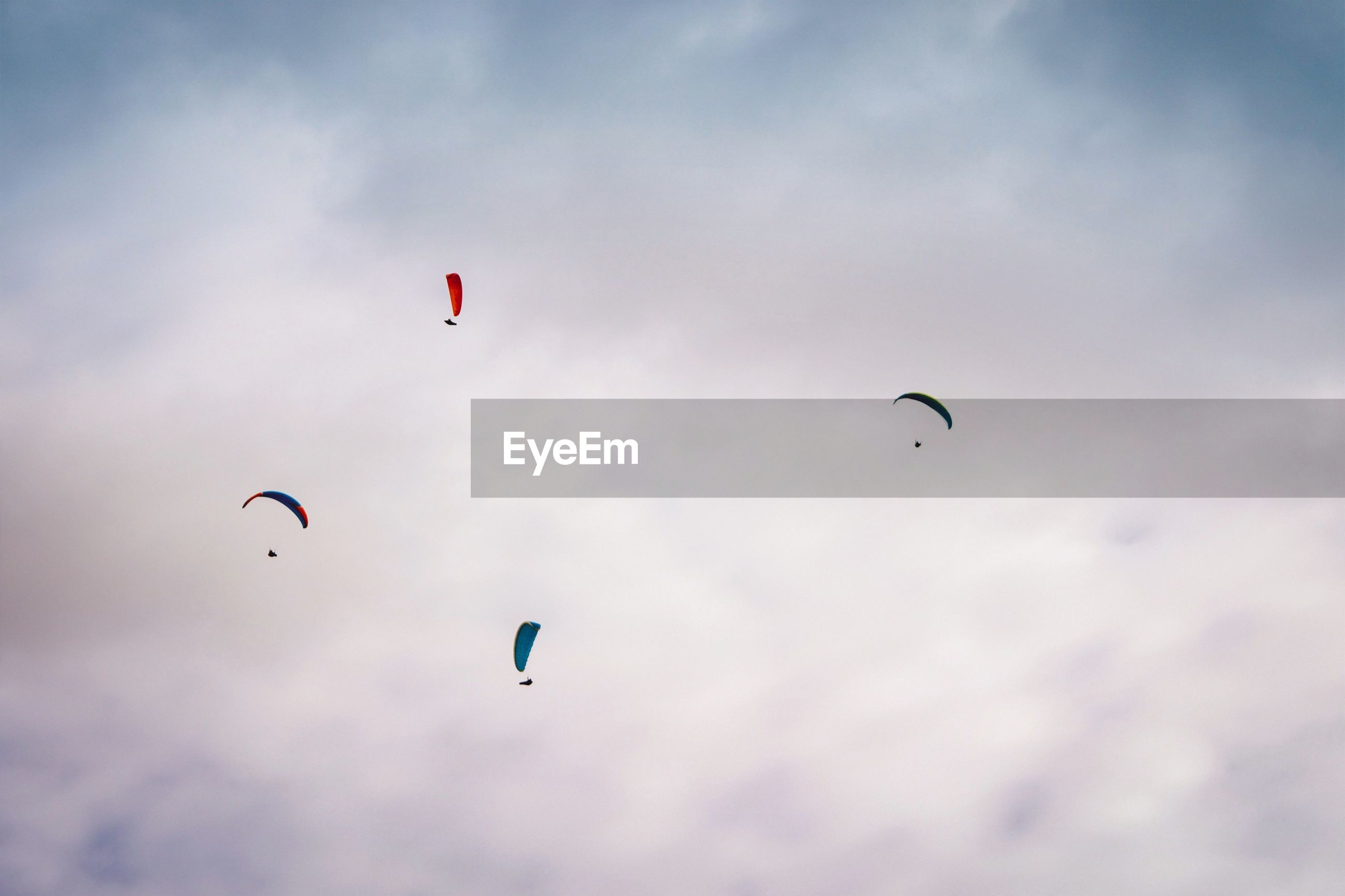 LOW ANGLE VIEW OF PEOPLE FLYING IN SKY