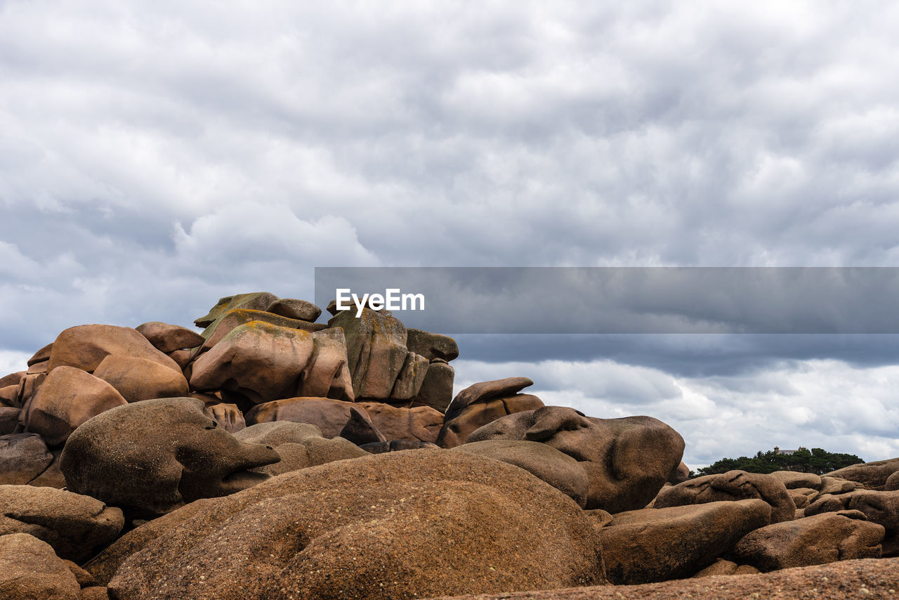 cloud - sky, rock, sky, rock - object, solid, beauty in nature, nature, no people, day, scenics - nature, tranquil scene, tranquility, overcast, rock formation, non-urban scene, land, boulder - rock, landscape, outdoors