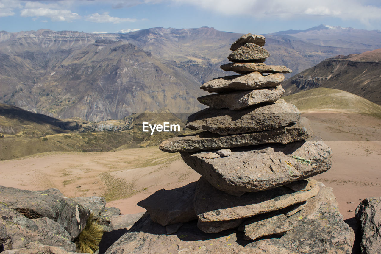rock, mountain, stack, rock - object, solid, tranquility, balance, beauty in nature, nature, sky, scenics - nature, tranquil scene, environment, landscape, day, mountain range, non-urban scene, land, cloud - sky, no people, outdoors, arid climate, mountain peak, climate