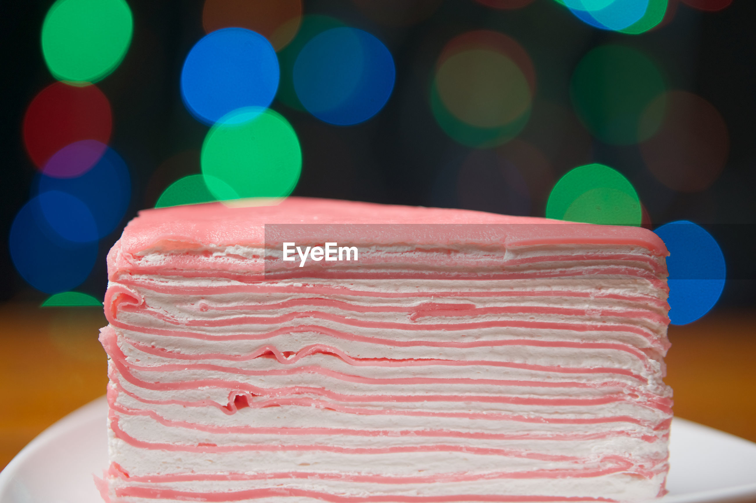 CLOSE-UP OF CAKE ON TABLE AGAINST BLURRED BACKGROUND